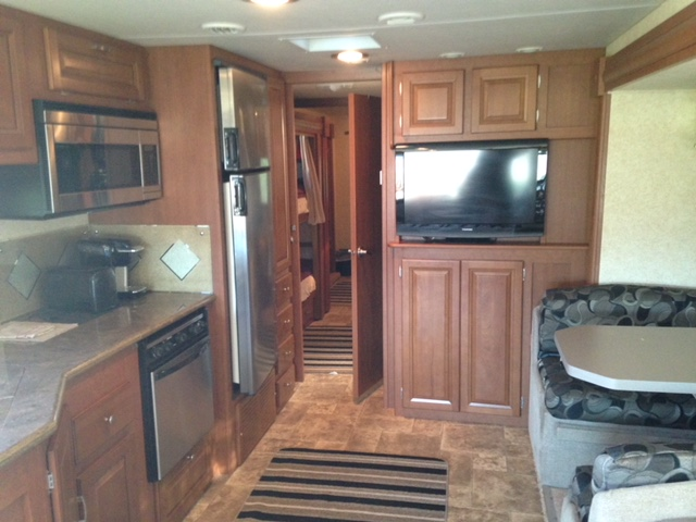 Kitchen and dinette set with storage beneath the seats.. Forest River Georgetown 2011