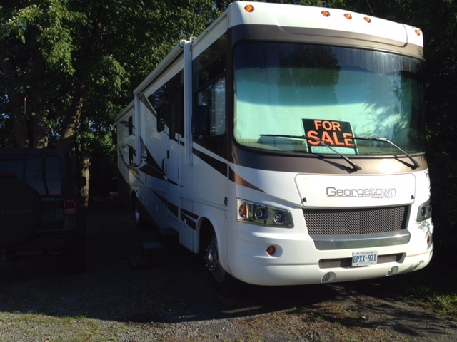 Outside view of RV Motorhome has 3 slide outs, lots of undercarriage storage space, electric awnings and three electric slide outs.  Electric self levelling.. Forest River Georgetown 2011