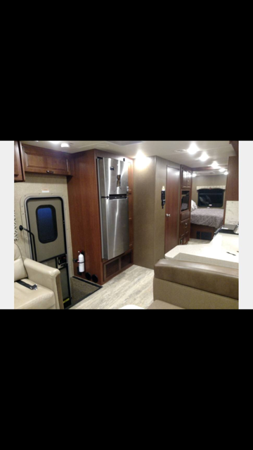 Looking from front to back.  Entry door on left. Residential Fridge. Thor Motor Coach Miramar 34.3 2014