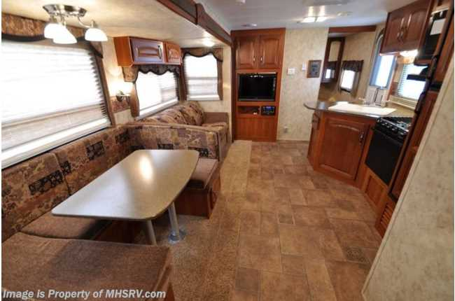 """This is the main cabin of the trailer, as seen from the """"hallway"""" to the 5-bed kids bunk-room.. cougar keystone cougar 31SQB 2012"""