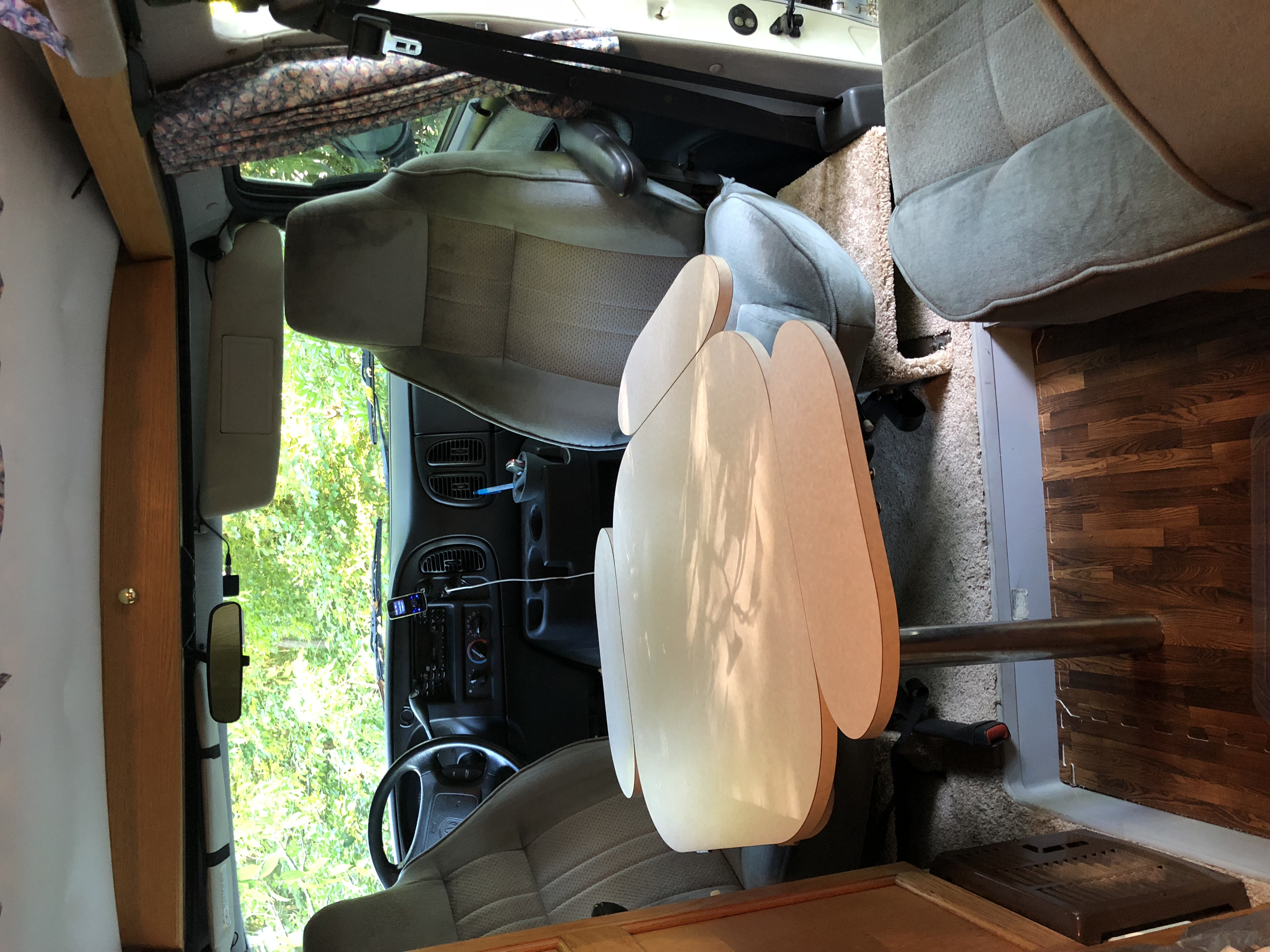 Swivel the front seats around and set up the cloverleaf table to eat or have a social time with friends.. Roadtrek 170 Popular 2001