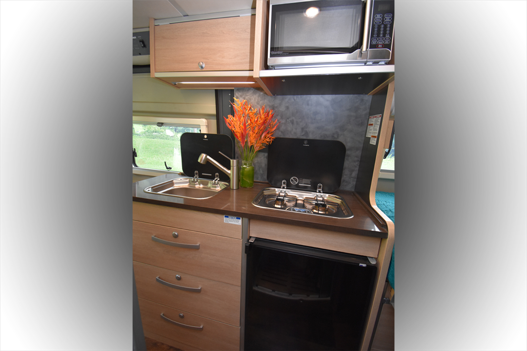 The feature packed kitchen includes a sink, gas cooktop, microwave and fridge and plenty of storage.. Hymer Aktiv 2018