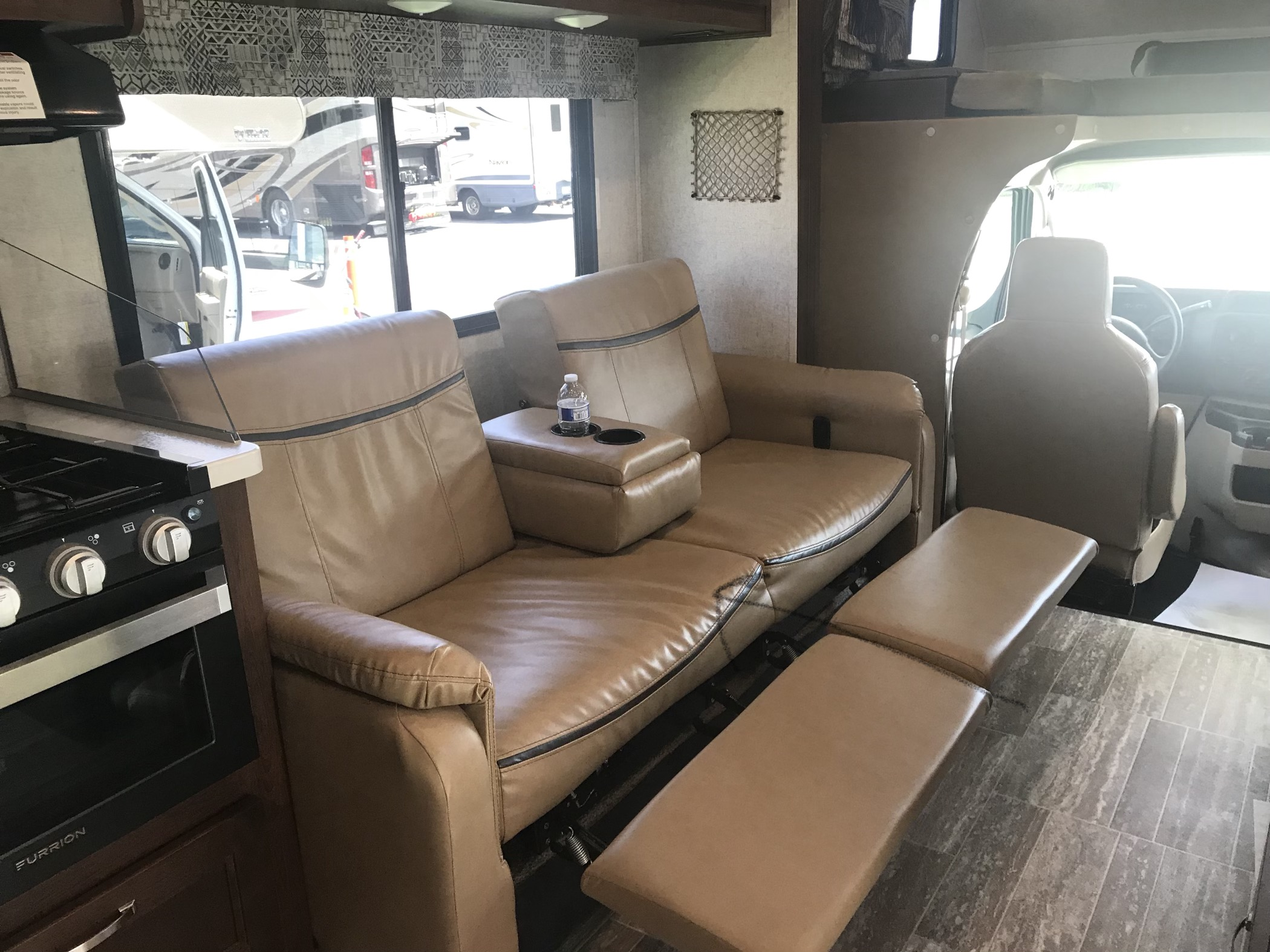 2 reclining chairs that are also Converted into a full-size bed. Forest River Sunseeker 2018