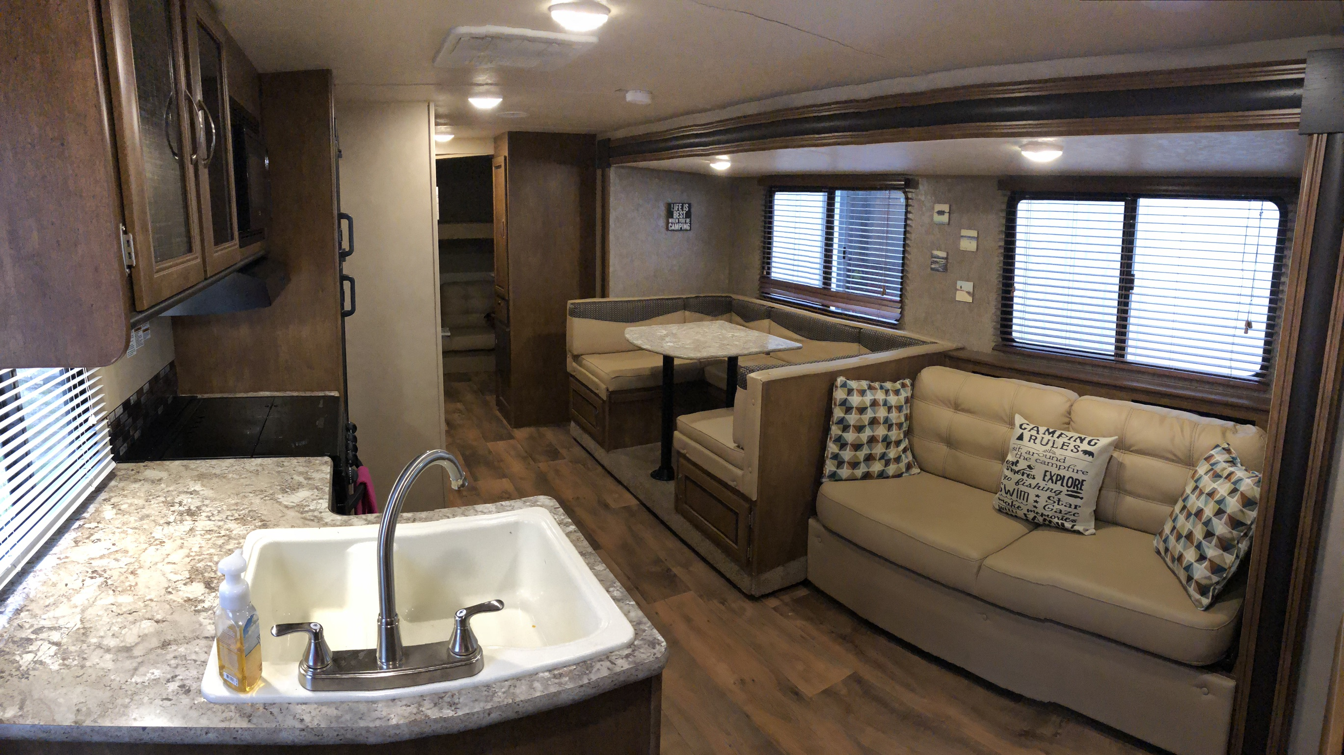 The open concept in the common area of the camper is spacious and comfortable with a large slide out, and ample storage.  . Forest River Cruise Lite 2017