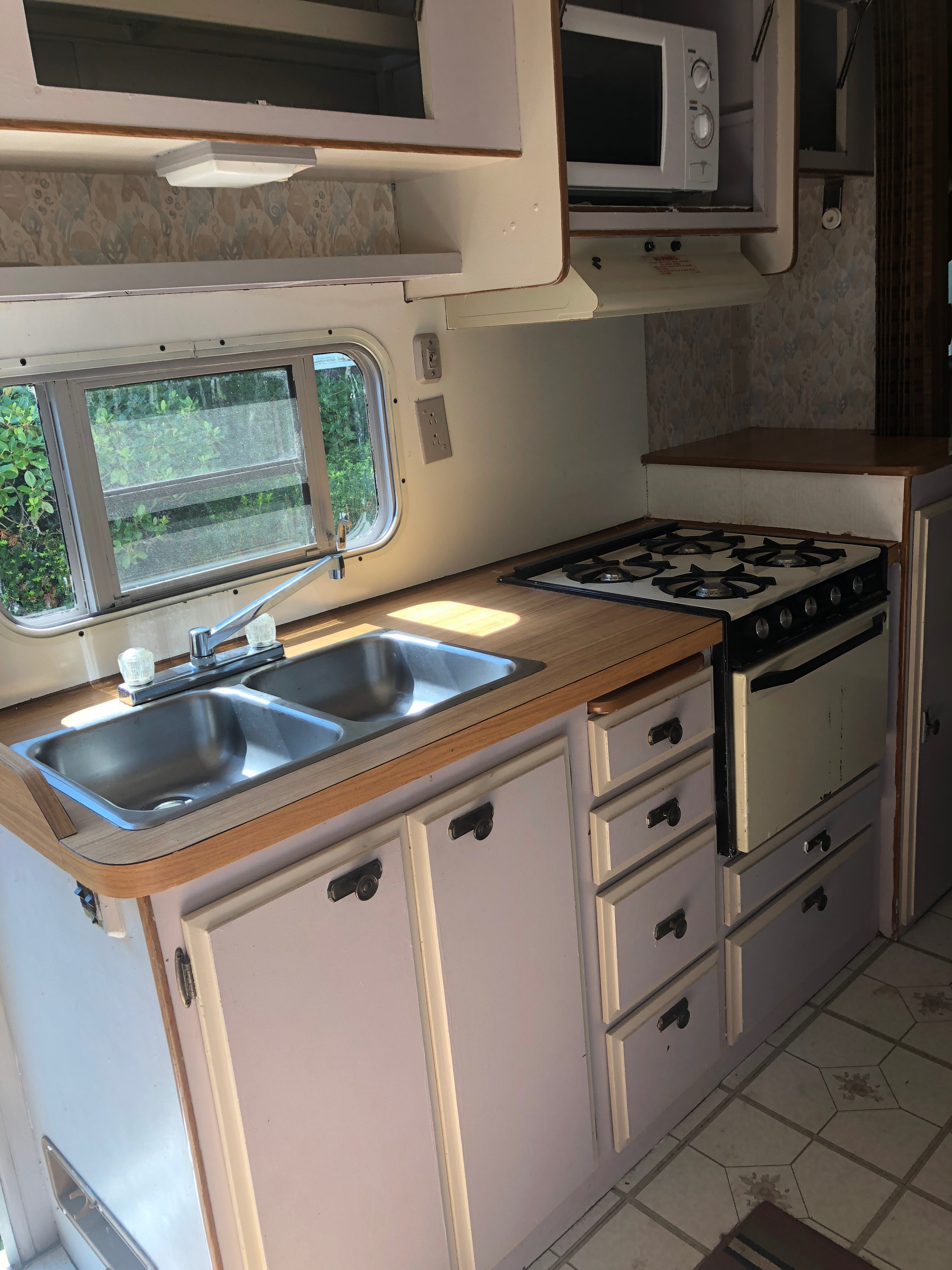 sink, stove, oven, and cabinets . Prowler FRWD 1986
