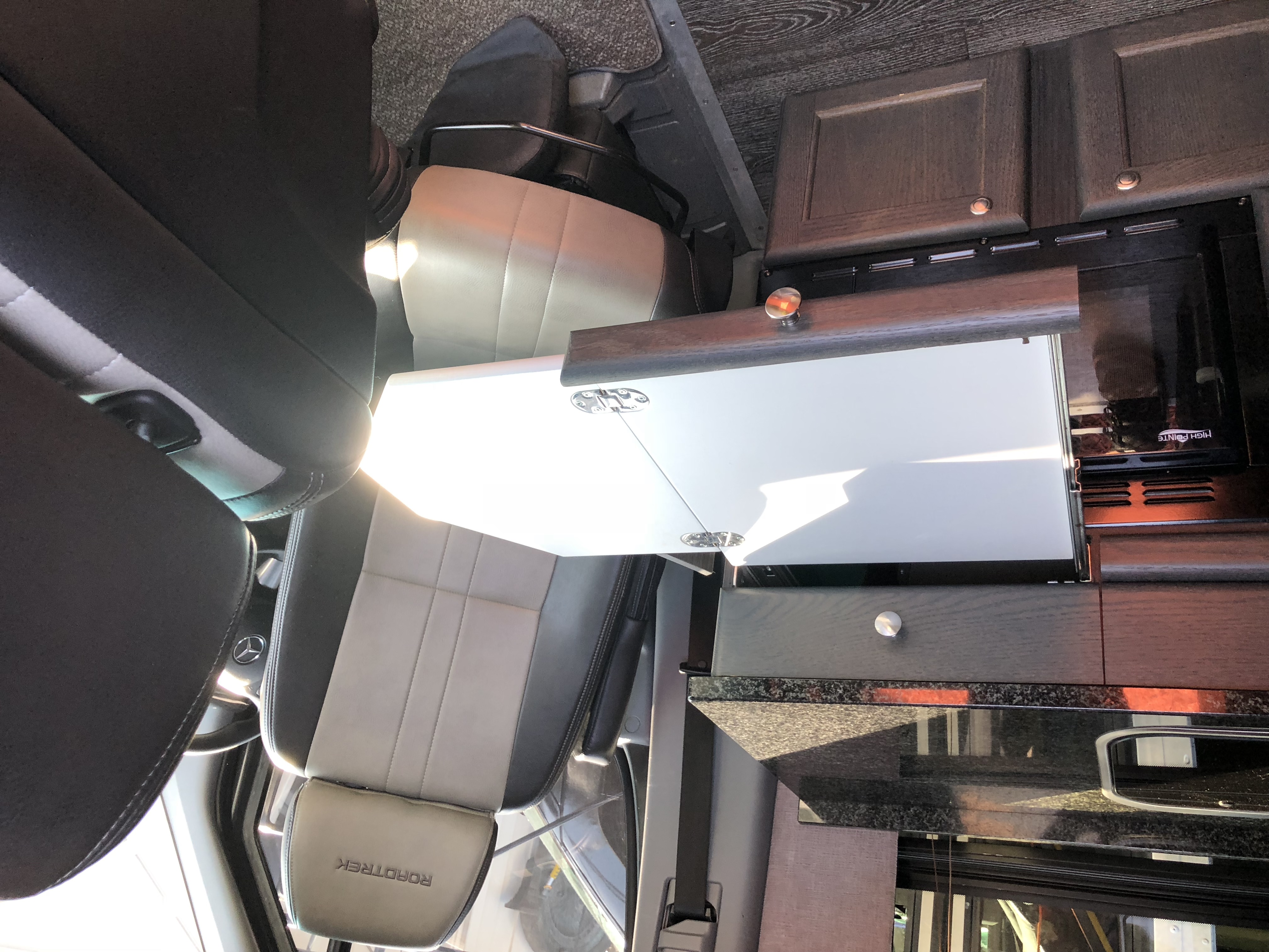 Driver's seat swiveled to pop out desk.. Mercedes Roadtrek SS Agile 2015