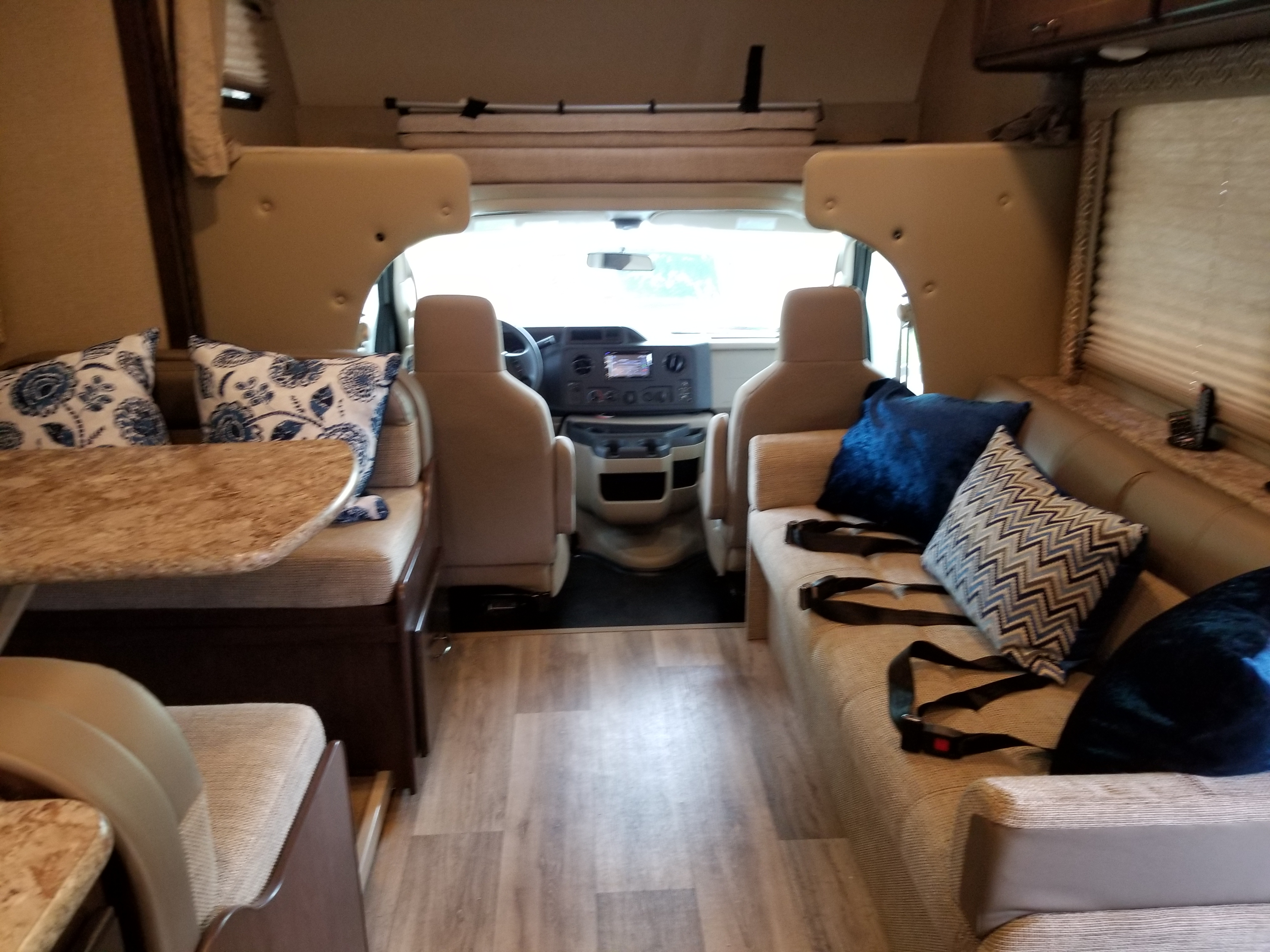 The Anywheremobile has a spacious interior.   Featured is the dinette that can seat 4 comfortably, a 3 seater couch, and a 500 lbs capacity overcab.  The dinette and couch convert into sleeping  areas and the over cab can be used as a sleeping area or for storage. . Thor Motor Coach Freedom Elite 29FE 2018