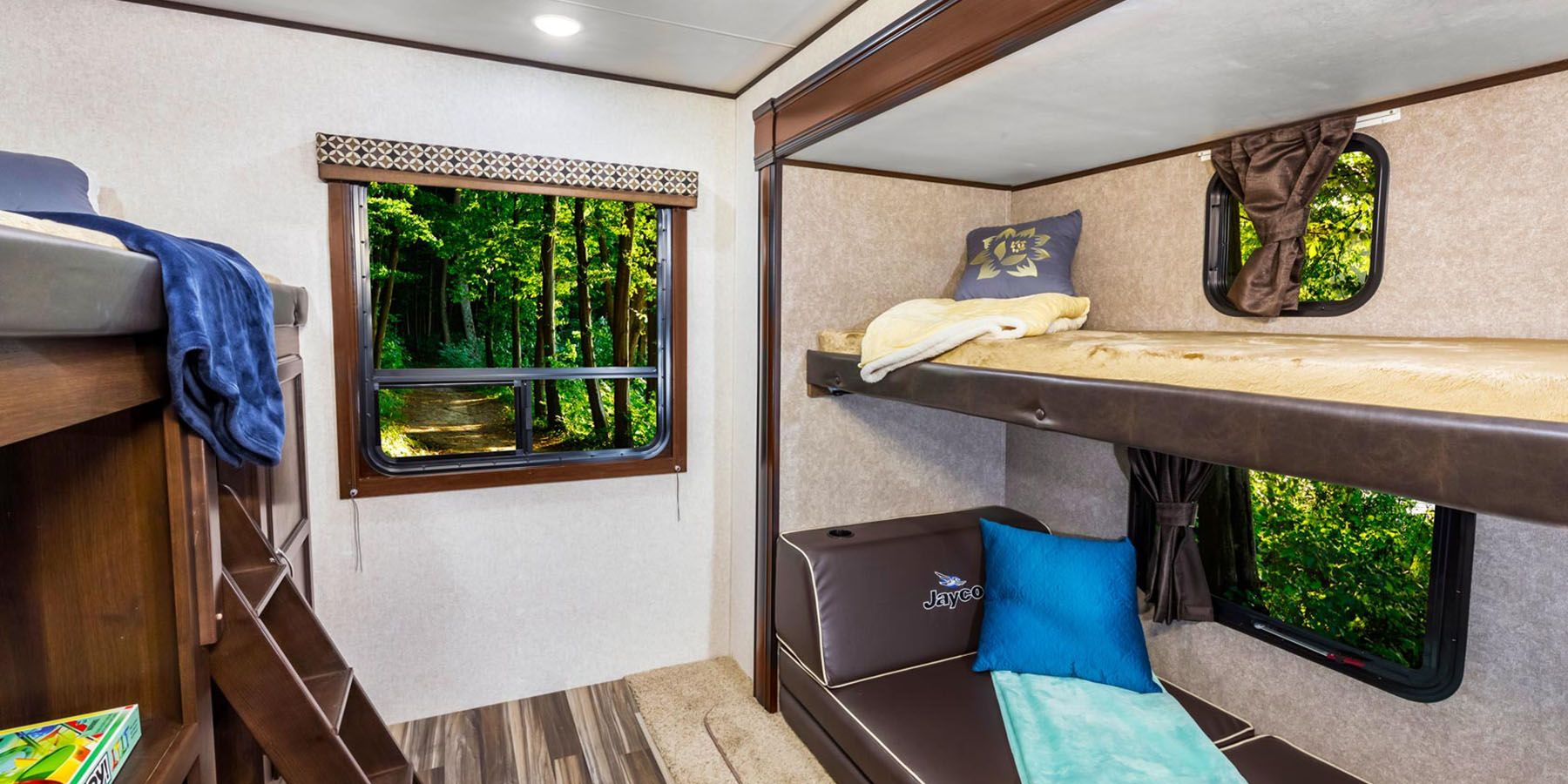 The top bunk folds upwards to give more space below for gaming or a potential workspace.. Jayco Jay Flight 2019