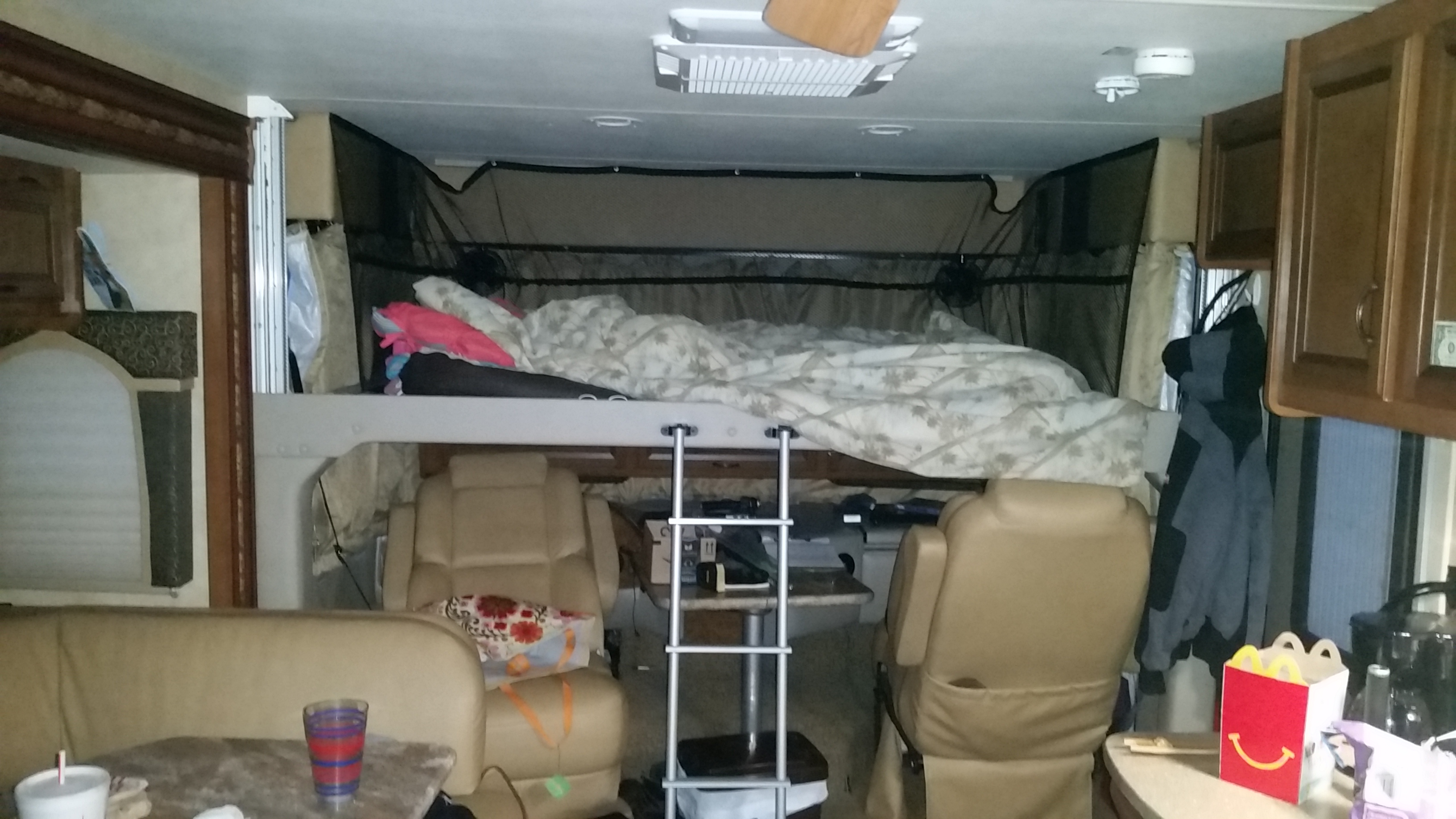 Front cab drop  drop down electric  bunk bed ,With ladder,. Thor Motor Coach Hurricane 2014