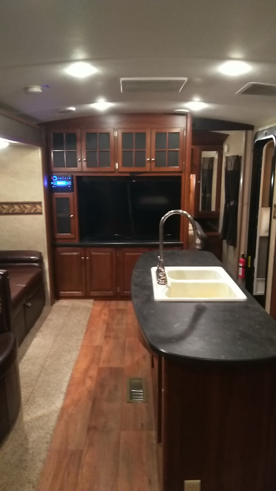 """Entertainment center with 50"""" tv and DVD player/radio CD player with indoor and outdoor speakers. Keystone Bullet Premier 2014"""
