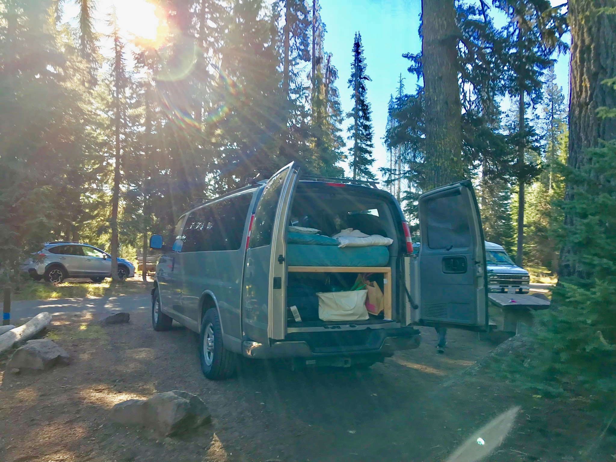 Picture of the van set up at Crater Lake, thanks to a previous renter.. Chevrolet Express Custom 2003