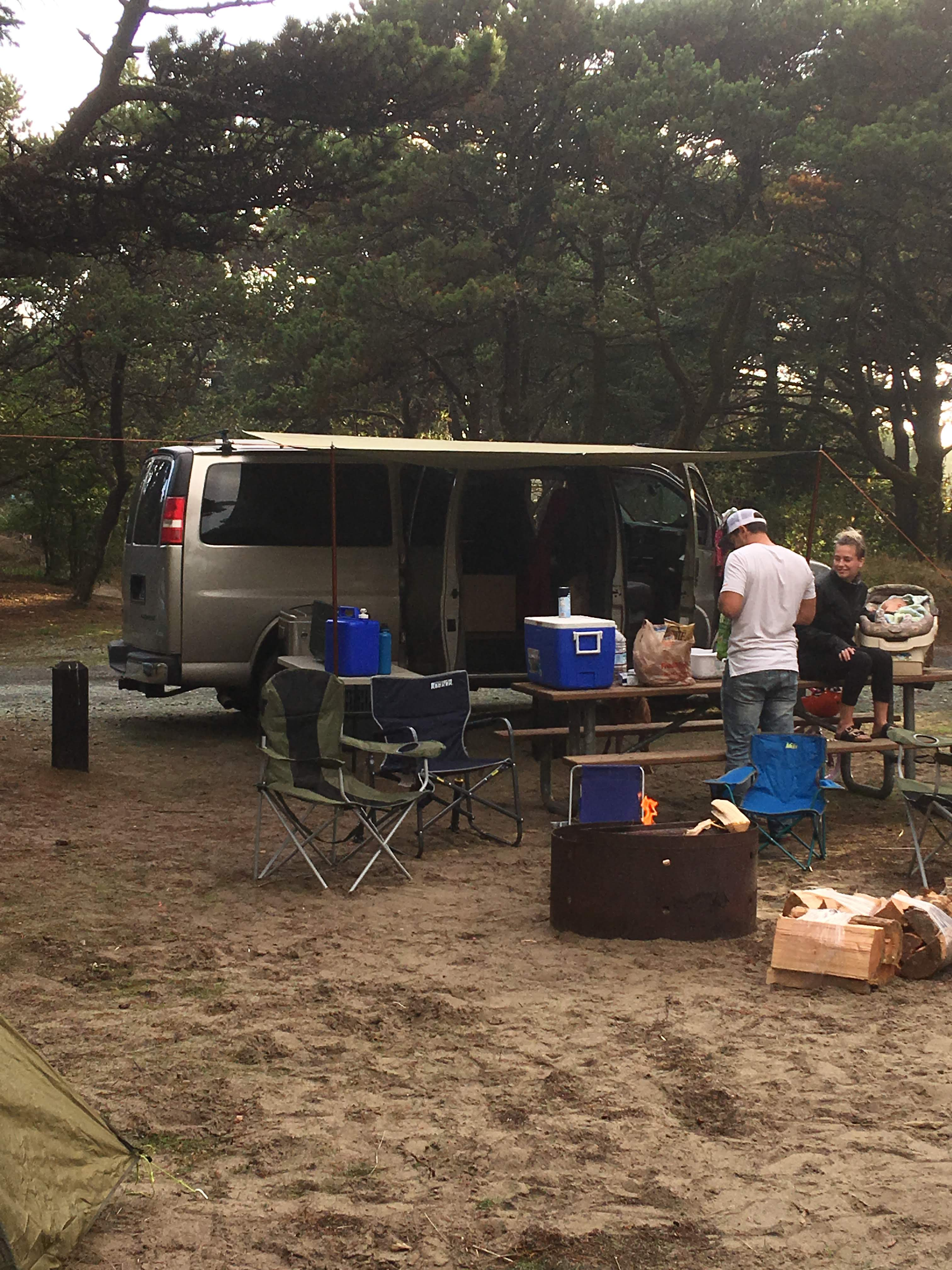 Picture of the van setup at the Oregon Coast. Awning sets up quickly for relief from rain and sun! Thanks to our guests for this photo!. Chevrolet Express Custom 2003