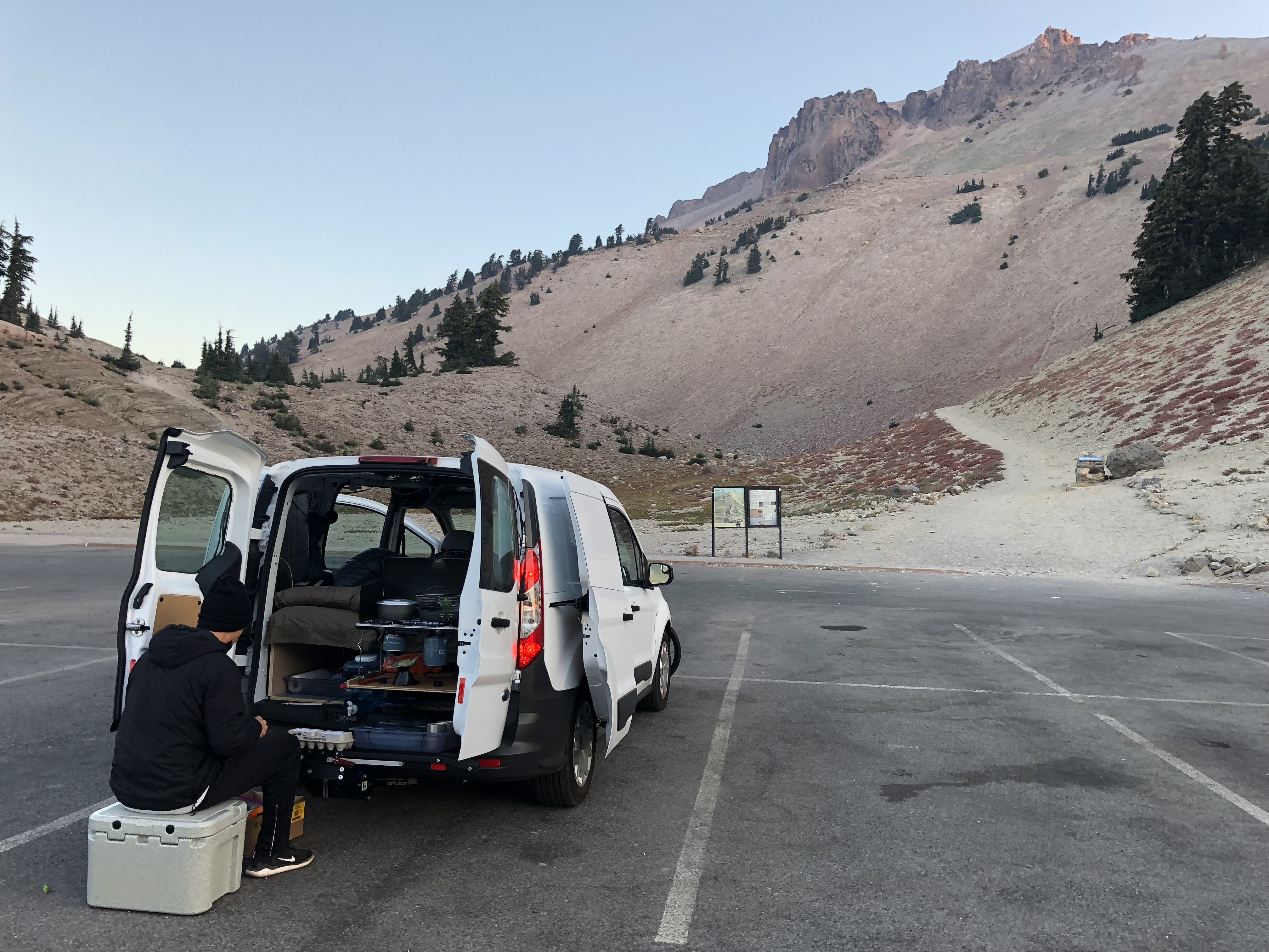 At the back is a two burner stove, MSR Windburner, cooler and other essentials. Easy for two to cook-up an excellent meal.. Ford Transit Connect SWB 2018