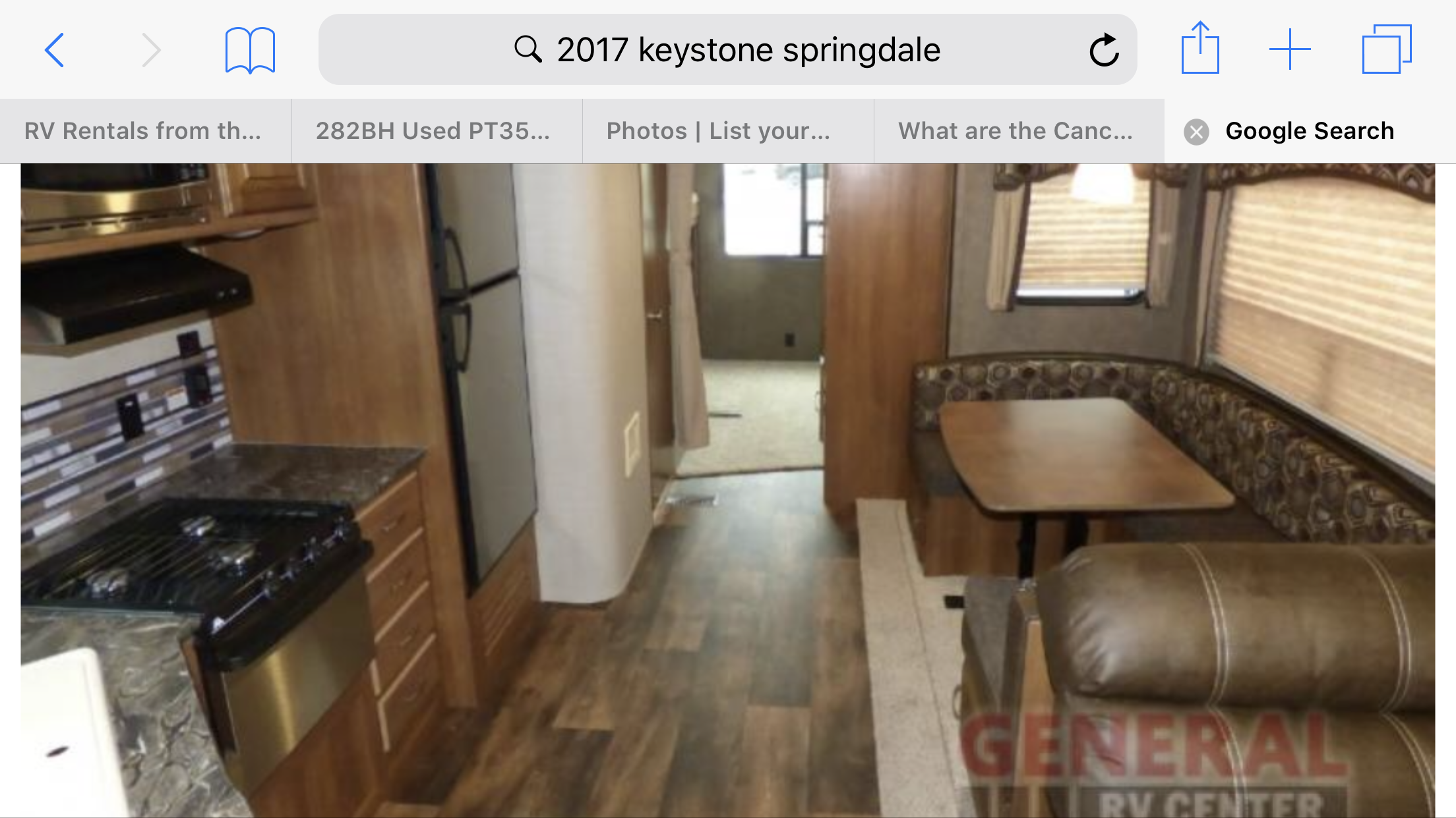 Spacious living area and kitchen with lots of windows and flat screen television. . Keystone Springdale 2017