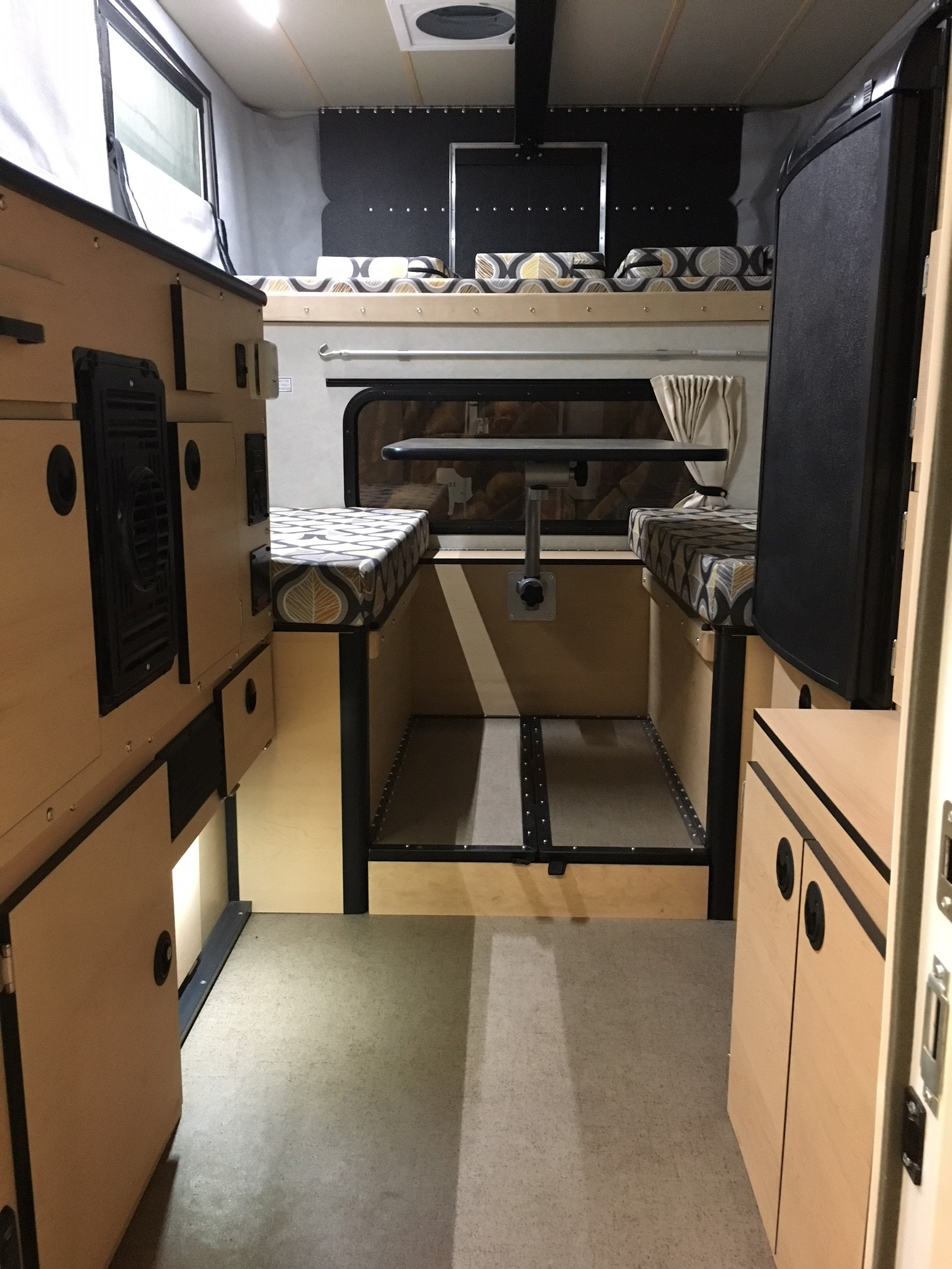 Dinette, cabinets, fridge on right. Ford w. 2019 Camper Grandby 2015