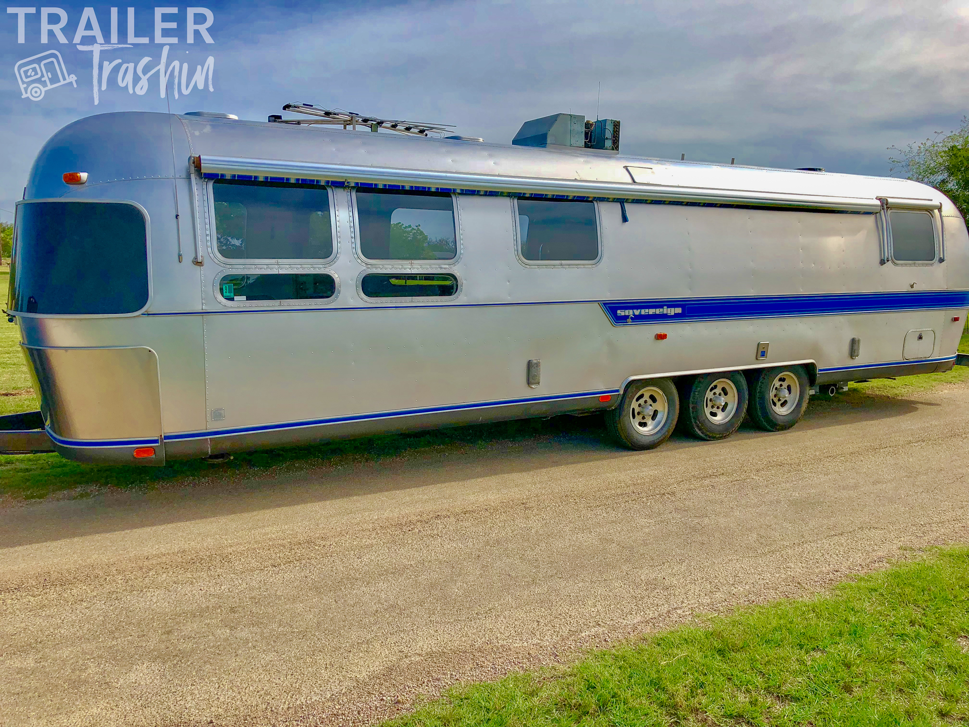 Exterior with four awnings surrounding the rig. . Airstream Sovereign 1985