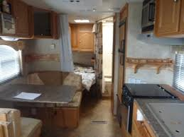 LIving space with the Jack and Jill beds in the rear.. Forest River Surveyor 2009