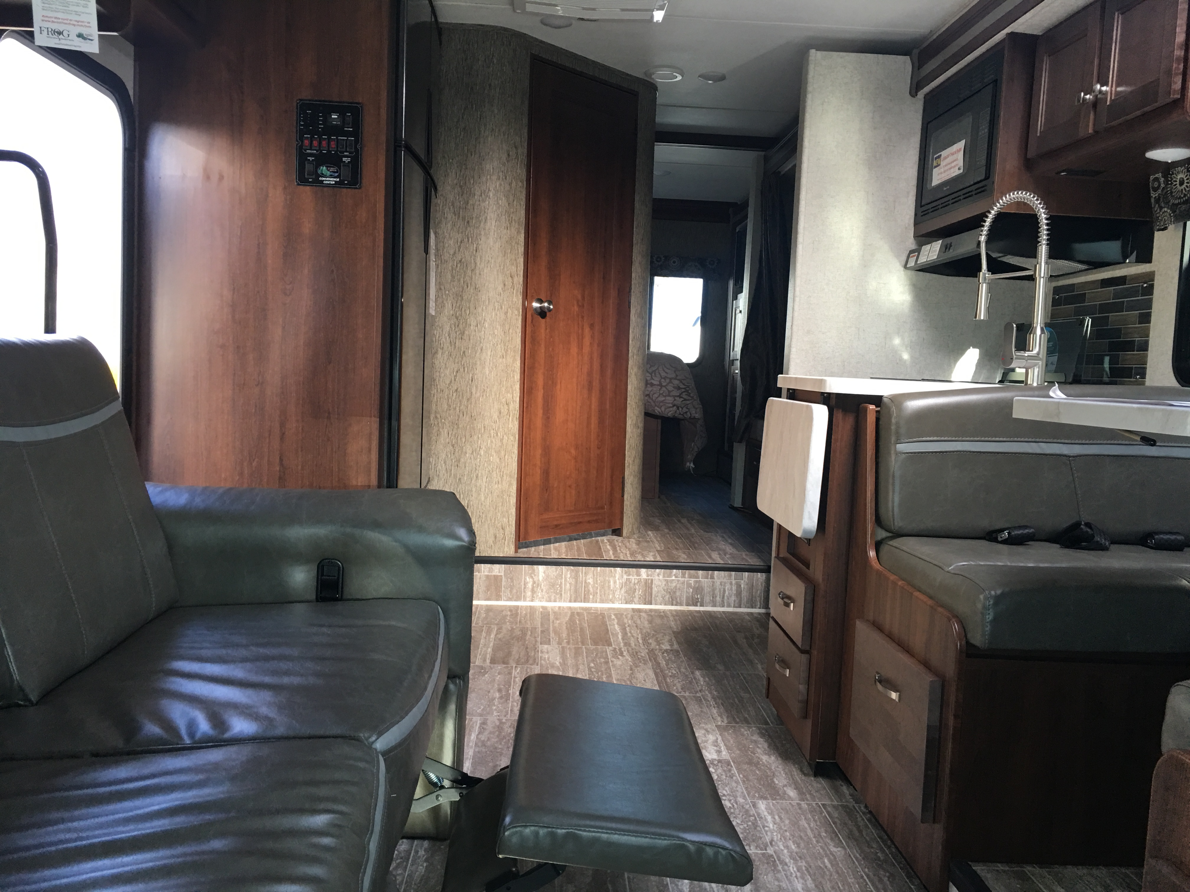 Couch can comfortably seat 3 people and includes seatbelts. 2 leg rest. Couch also converts to a bed.   Dinnette has 2 latches for car seat capability. Also turns into a bed.  Picture shown is with slide out. Forest River Sunseeker 2018