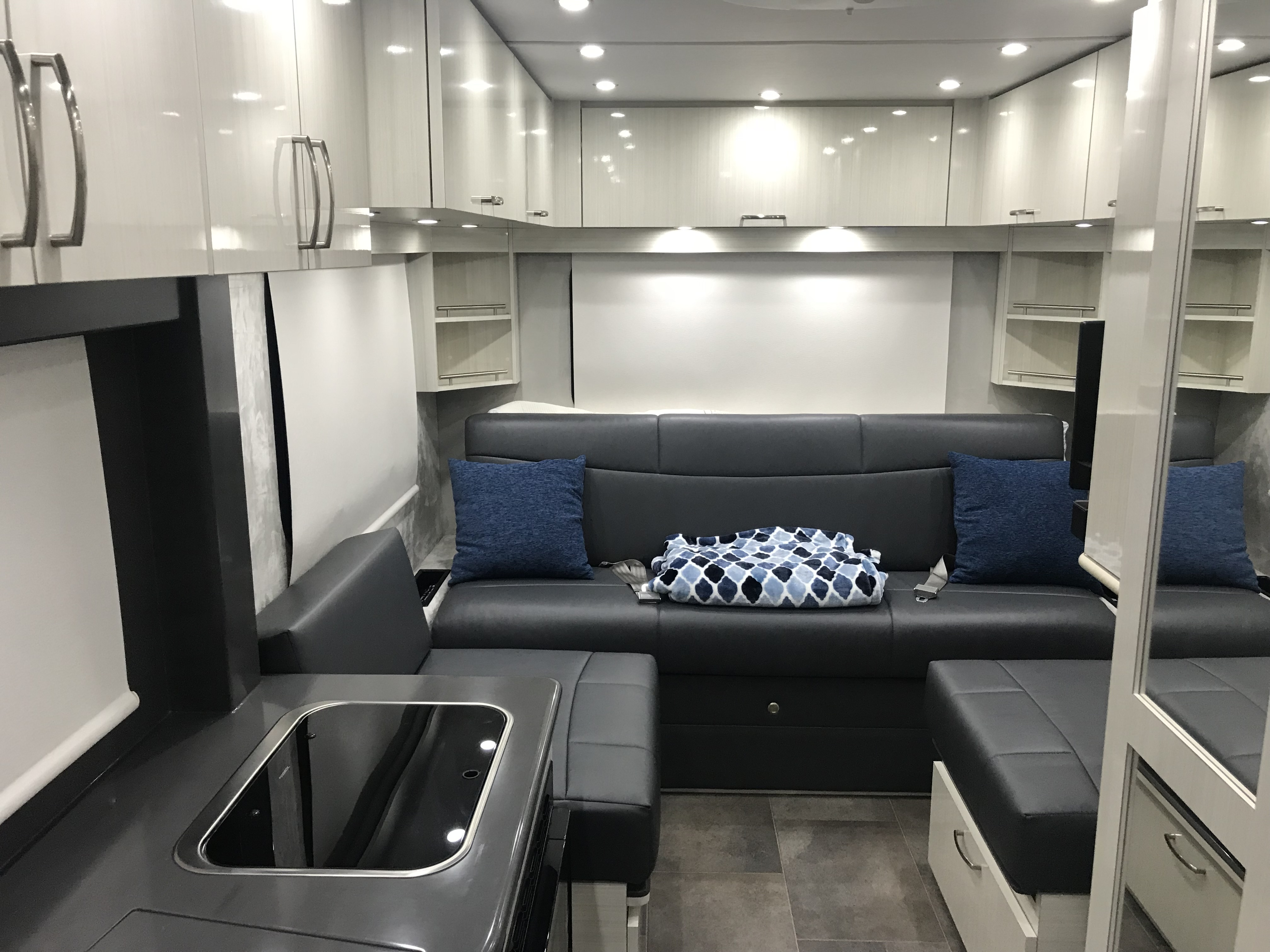 Coach/seating area, the table is put away in this photo.  It has 2 seat belts so you can safely secure passengers for a total of 4. . Pleasure Way Plateau XLTS 2019
