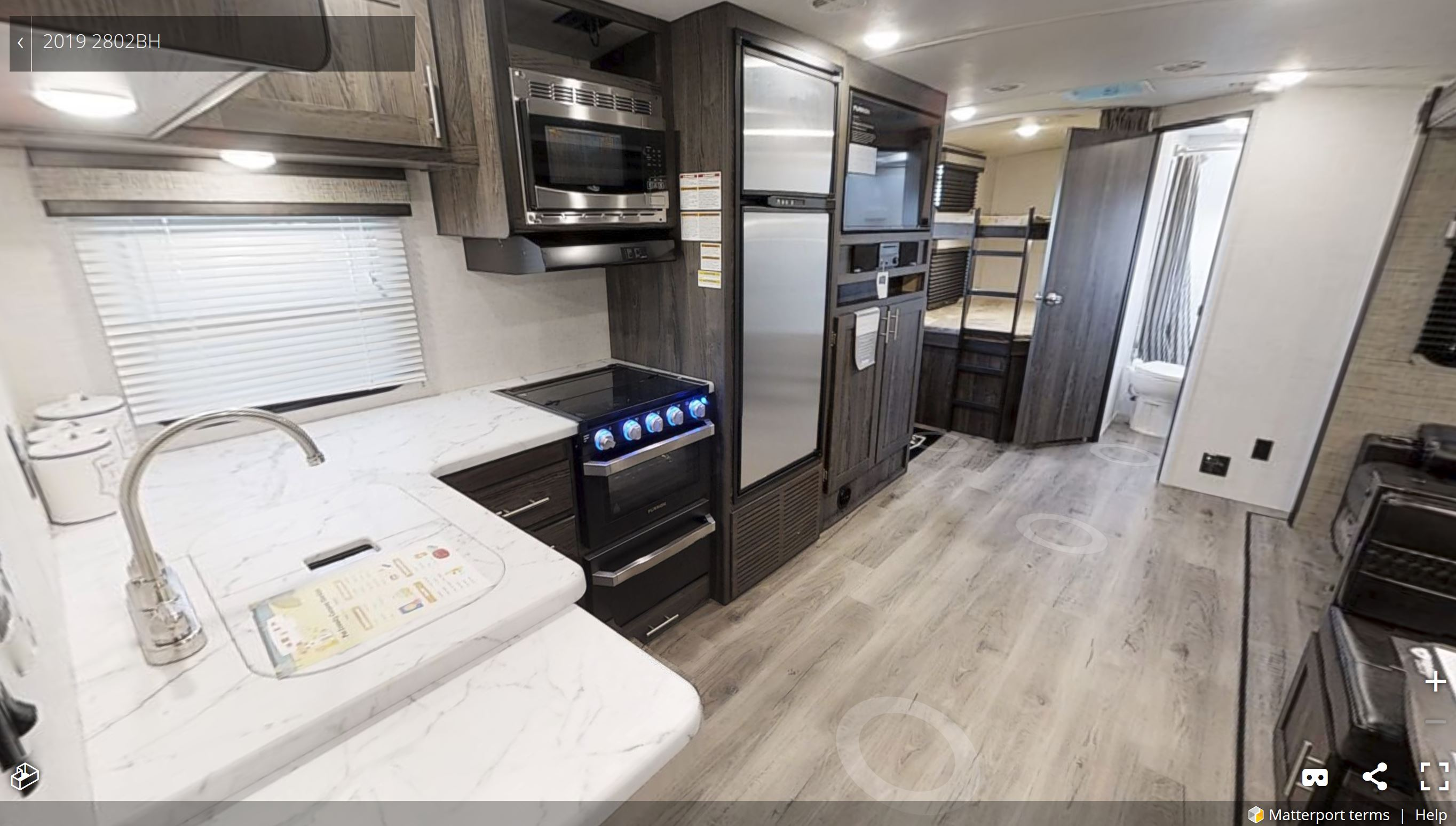 Spacious kitchen, luxury RV appliances, large fridge & freezer.