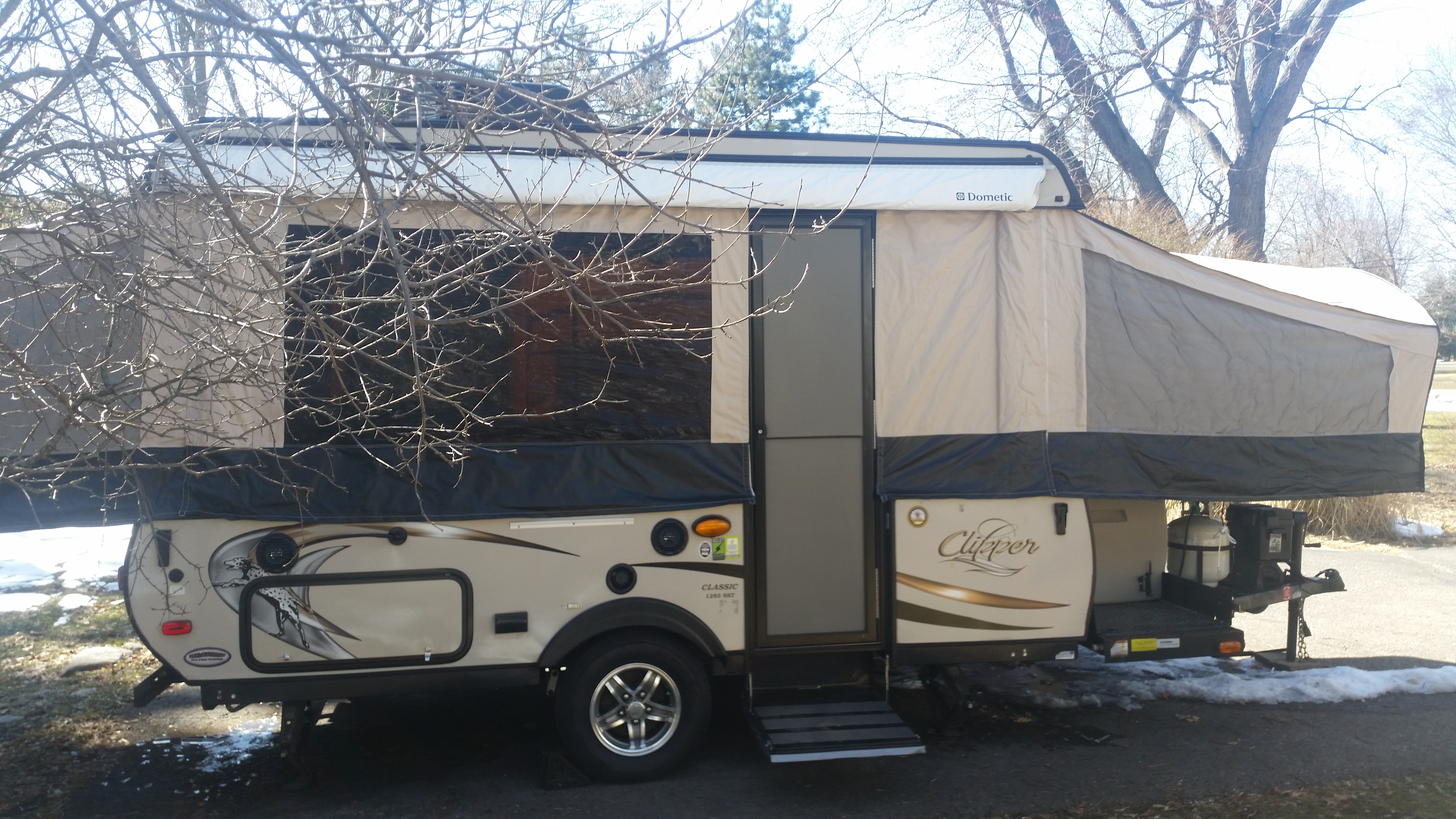 easy set up with an awning, not extended in the photo, but we'll show you how to set it up when you pick up the Clipper!. Coachmen Clipper 2016