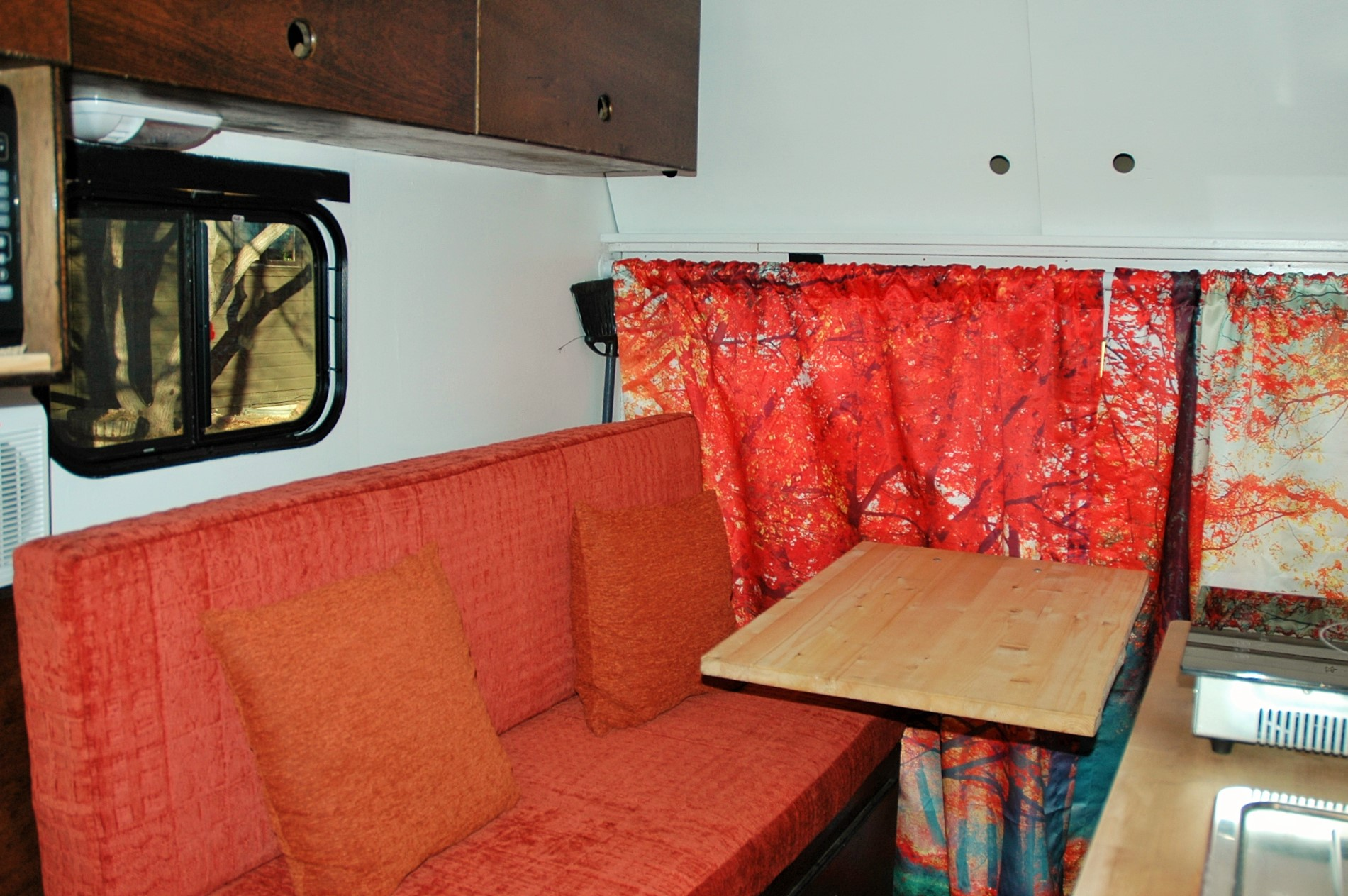 The seating area has a window and upper cabinets that lock.  The sofa. can be an extra sleeping space.  . Ford E350 Box Van 2012