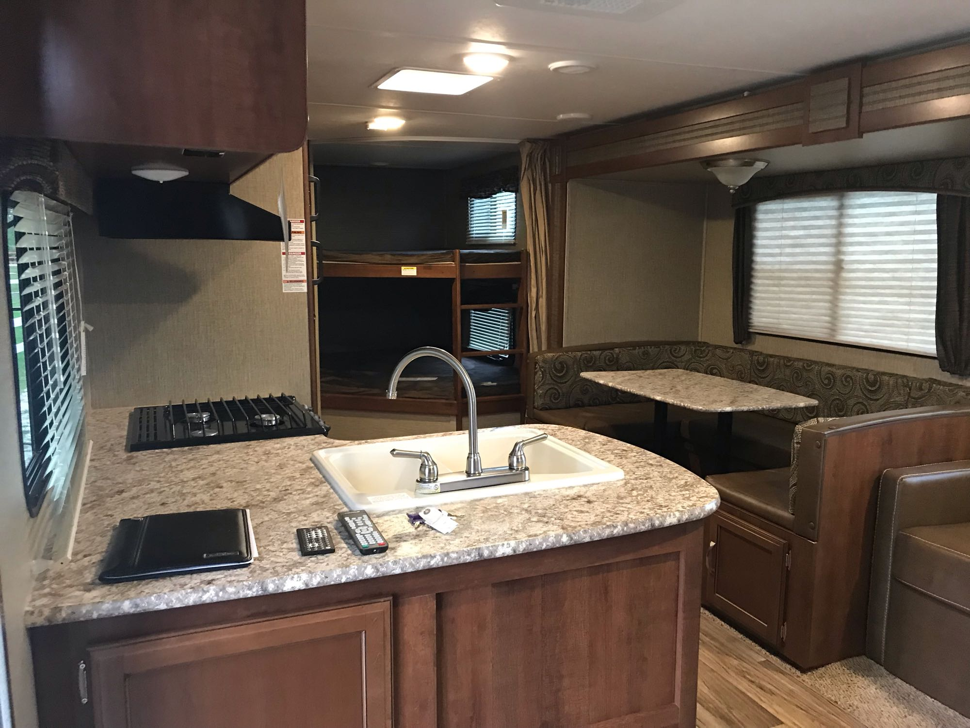 full kitchen, dinner table that turns into bed . Keystone Passport 2017