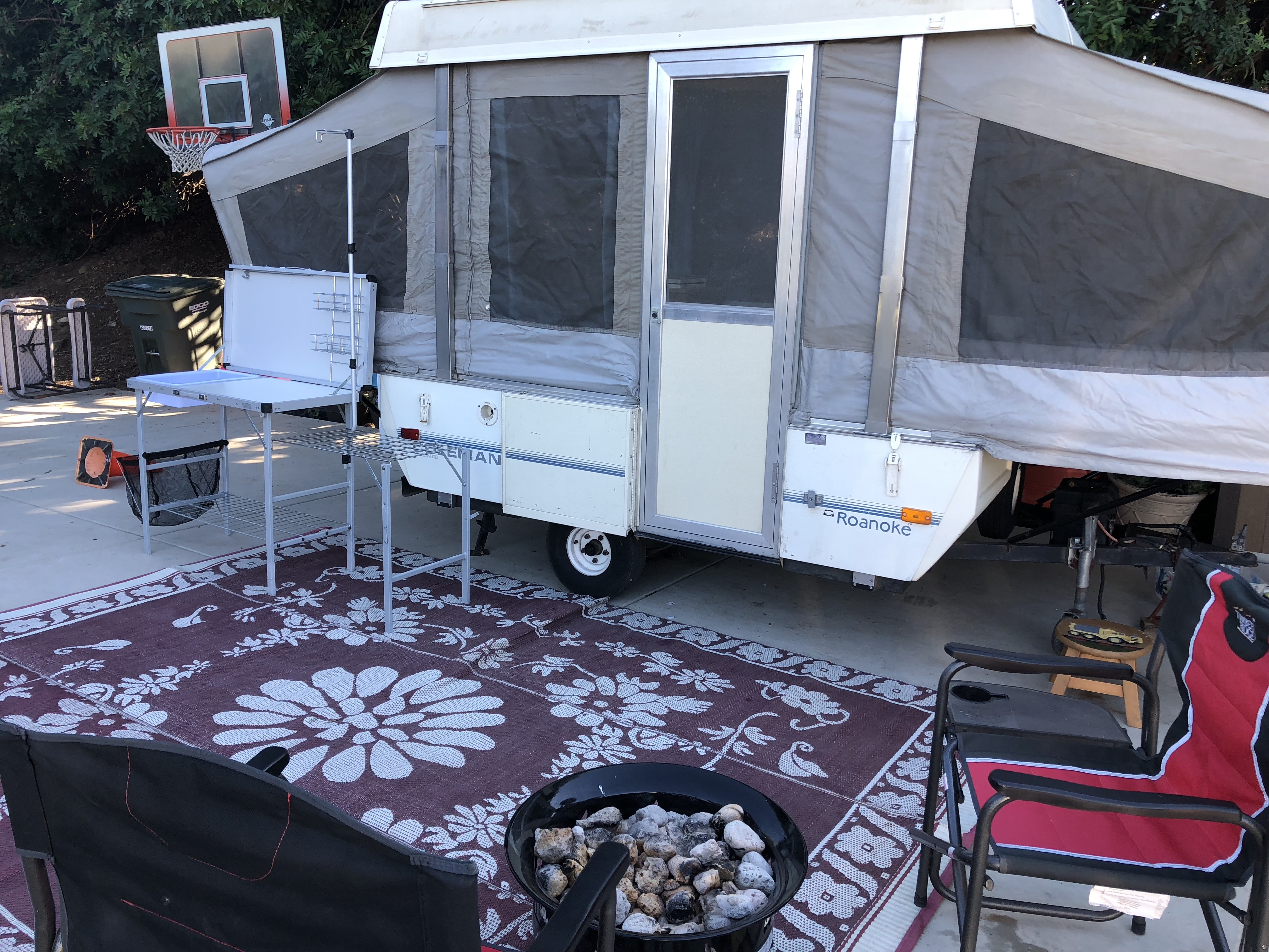 Set up with sink and dirt mat in front of trailer. Coleman Other 1991