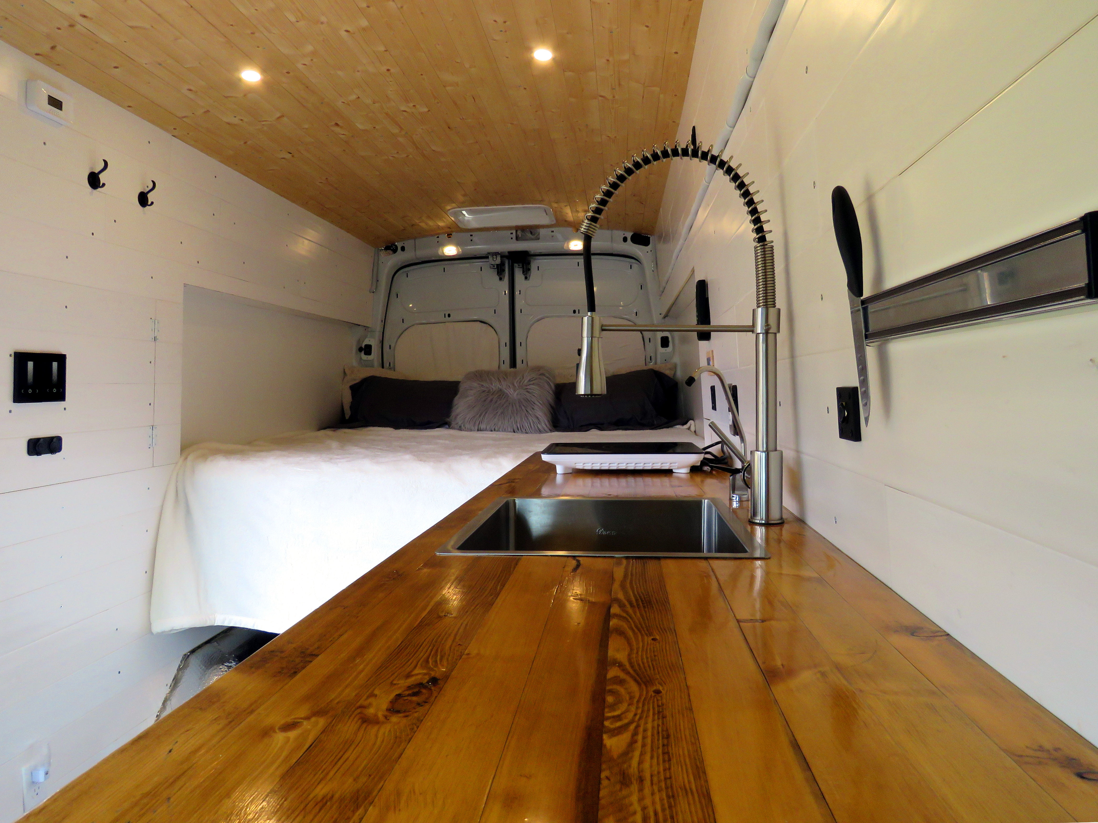 Custom made counter top and industrial style faucet for easy use.. Ford Transit 2016