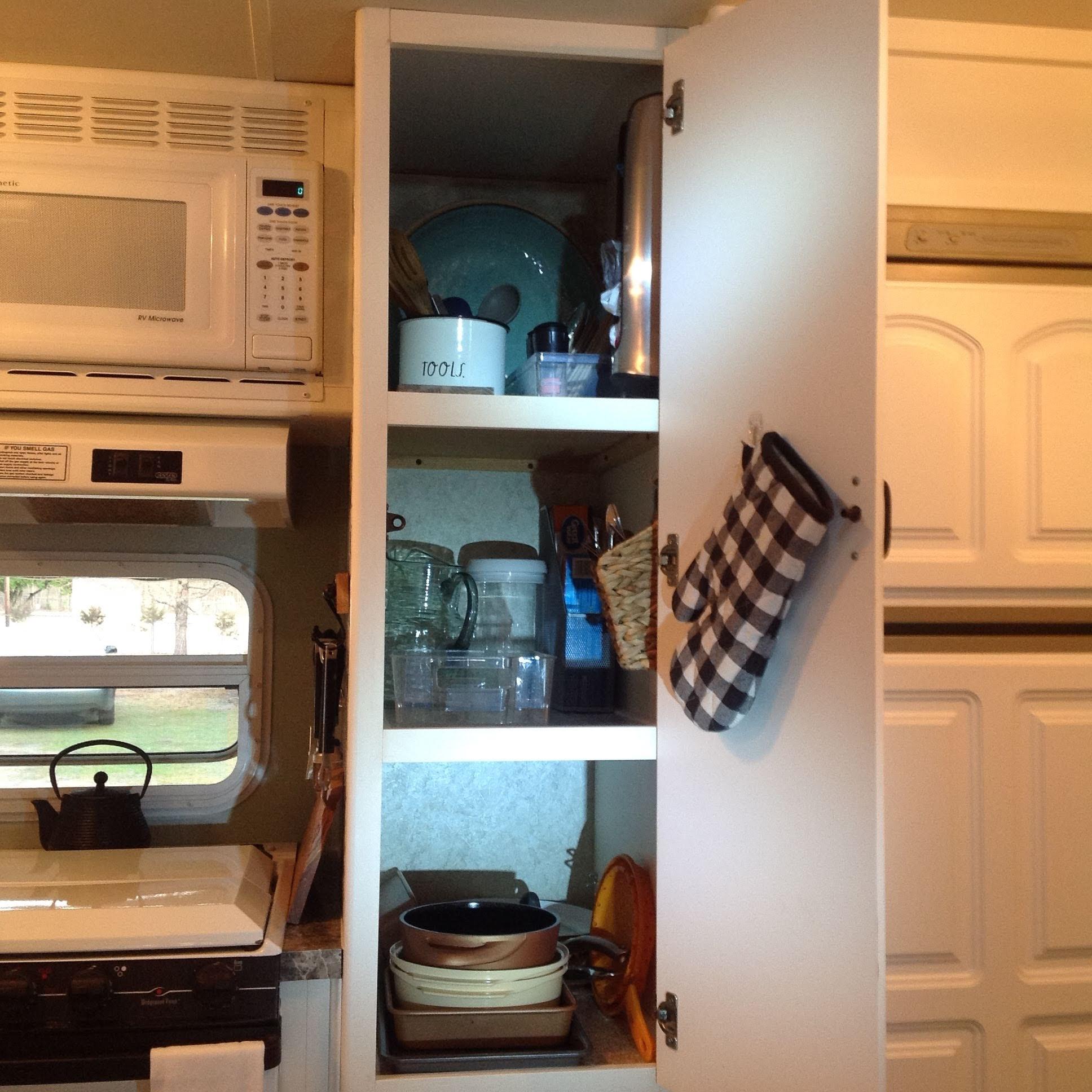 Fully stocked kitchen: plates, bowls, silverware, pots, pans, utensils, measuring cups, etc. . Starcraft Aruba 2003