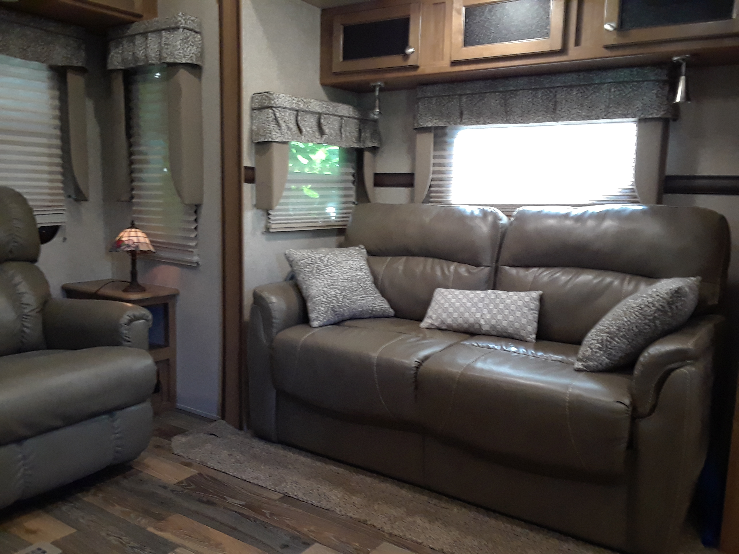 Tri fold cushy leather couch sleeps 2, Over head reading lights, over head storage and ceiling fan with light.  This living area has had 10 people and still had room.  . Forest River Rockwood Signature Ultra 2017