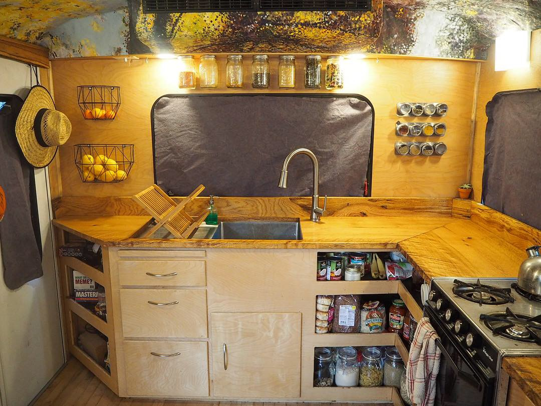 Full size sink and lots of counter space kitchen big enough for three to cook at the same time.  . Ford E450 2008