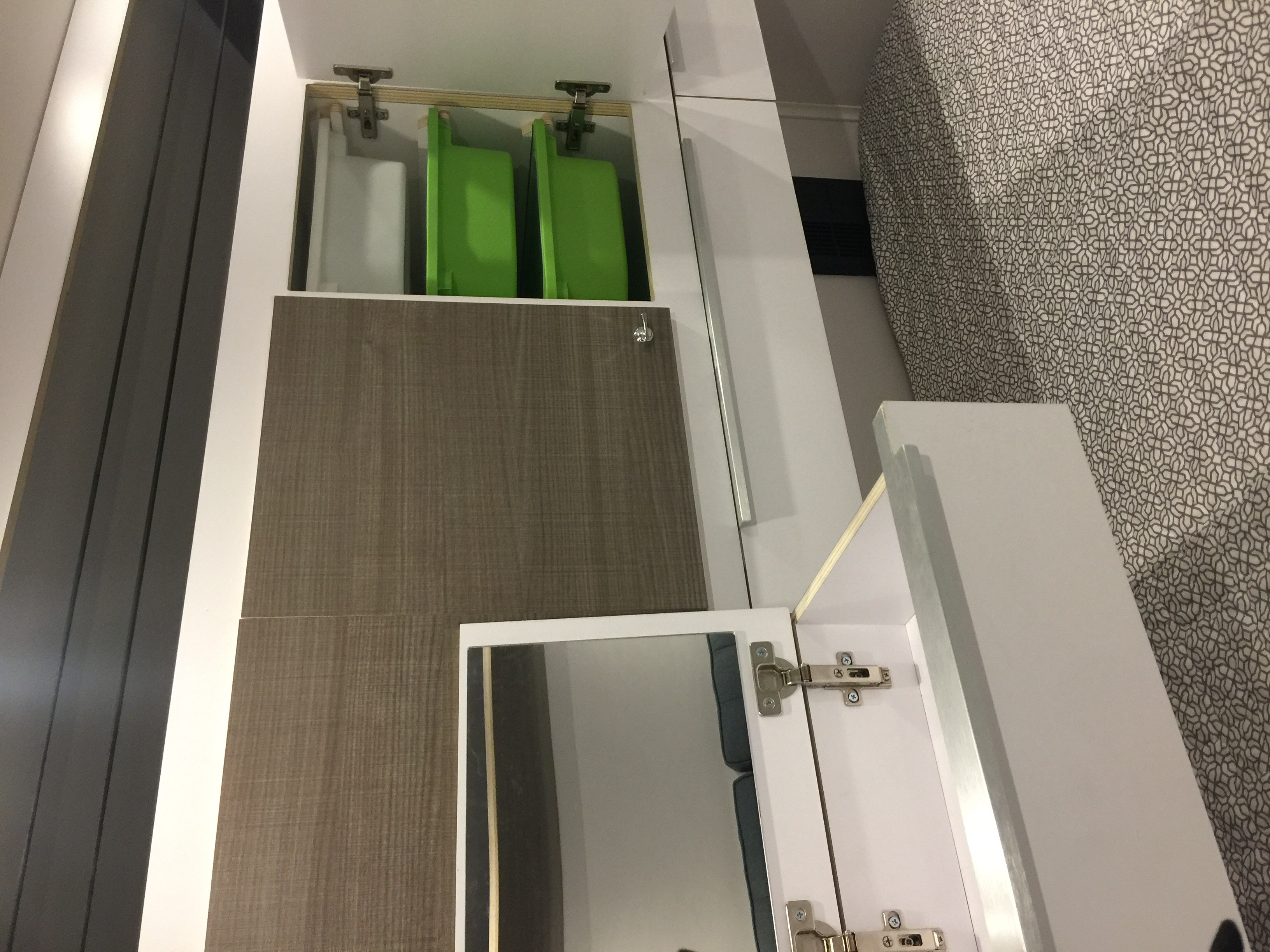 View is of cabinets at the foot of the bed.  Lower drawers pull out, a perfect spot to perch a lap top.  Electrical outlets and USB ports in the cabin as well as convenient cup holders, phone shelf puts all your necessities at hand.. bean bean stock 2018