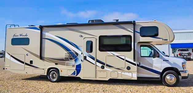 Great exterior with awesome 16' automatic awning equipped with a full LED light strip and an outdoor TV for all to enjoy great evening movies or that game you can't miss!. Thor Motor Coach Four Winds 2018