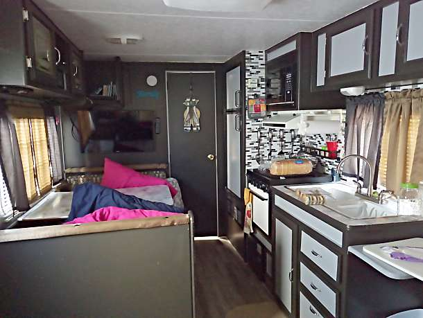 Table folds down to bed sleep 2 also has a fold down couch which could sleep 2 as well.. Skyline Nomad 1996