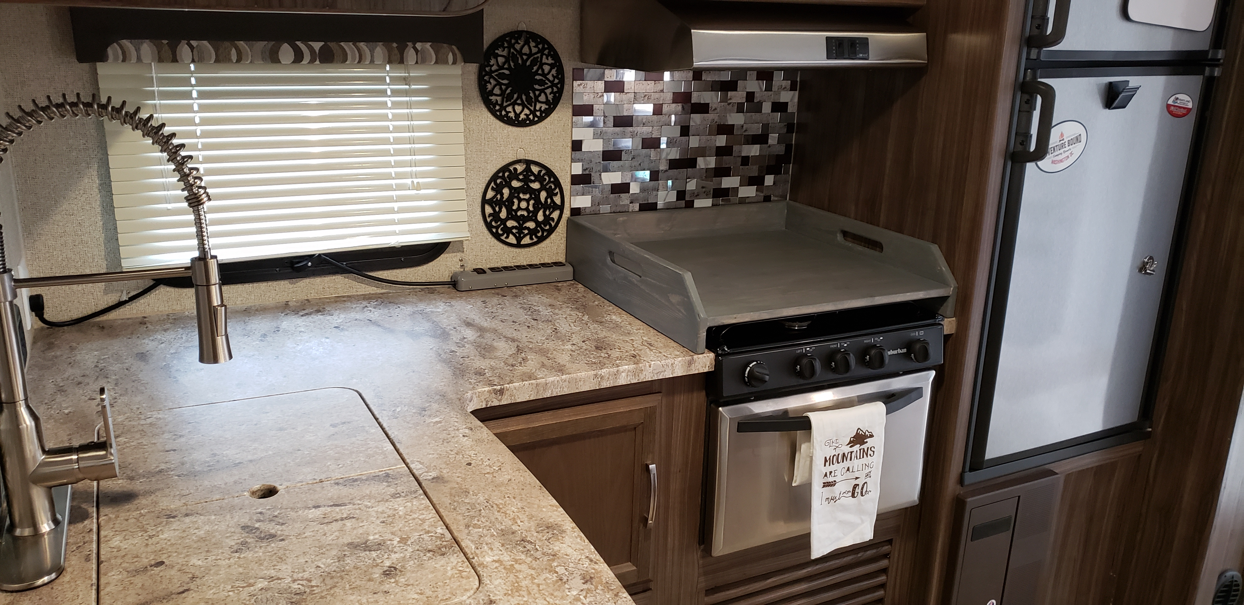 Cover over stove to increase counter space . Coachmen Apex 265rbss 2019