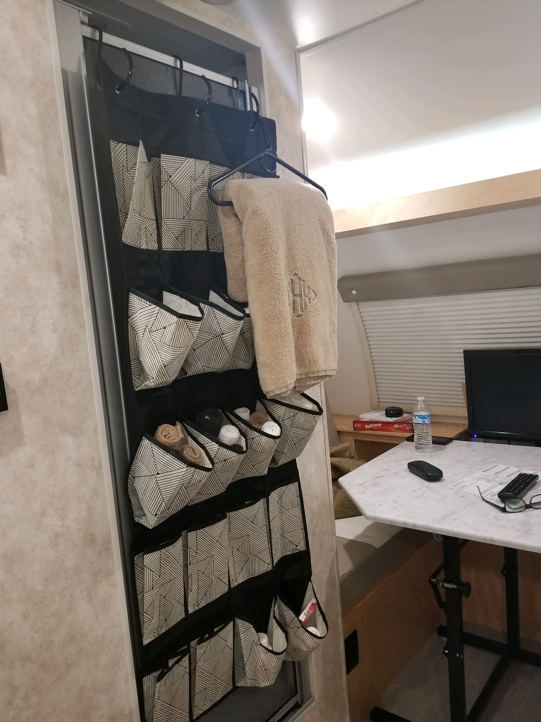 Shower door w/ organizer and dining area w/ table up.. Little Guy Max 2019