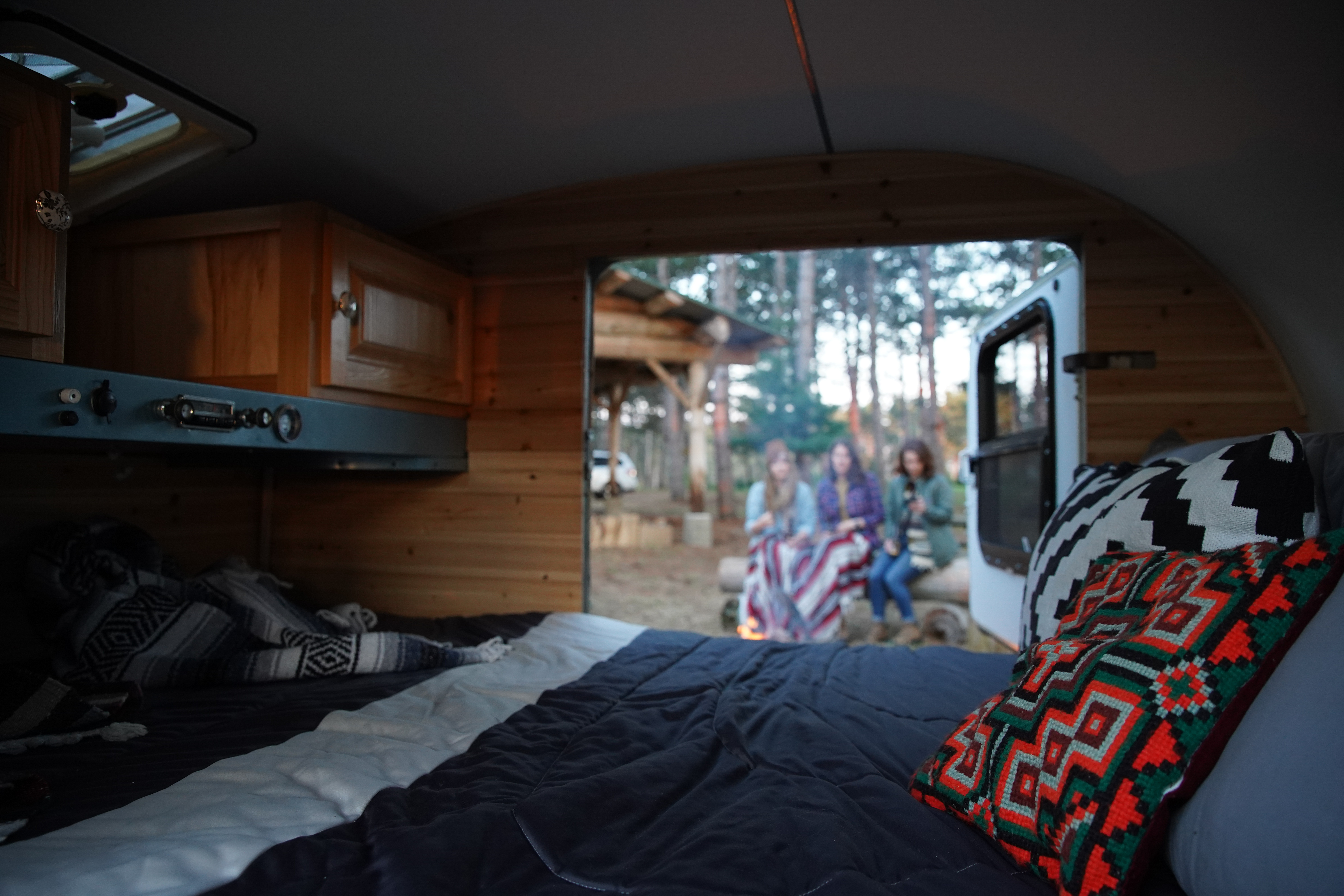 sleeping area measures the width of a queen and the length of a full size mattress. Linens, comforter and pillows are included. Custom Teardrop Camper 1945