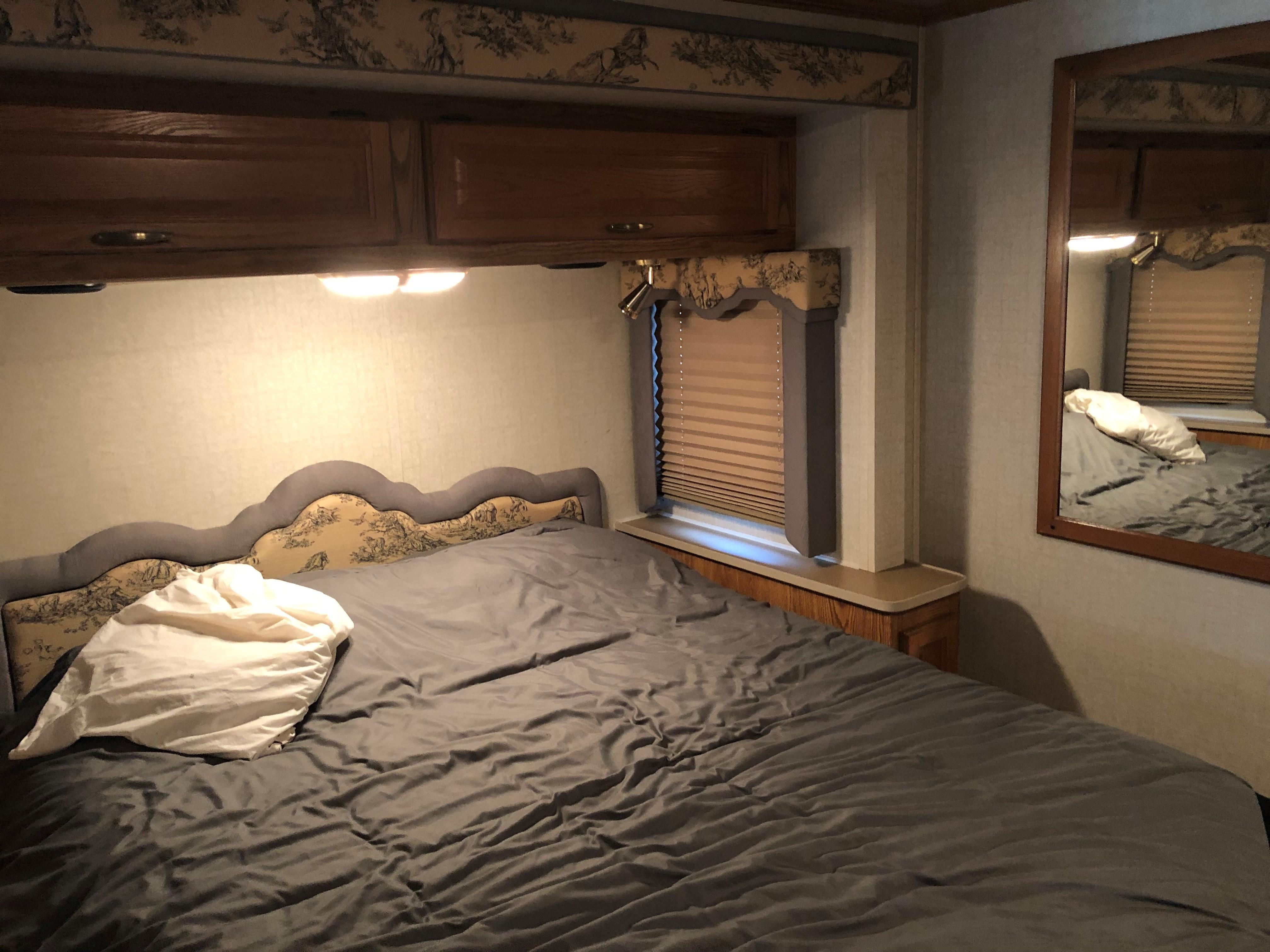 Master bedroom with very comfortable queen bed. Fleetwood Bounder 2004
