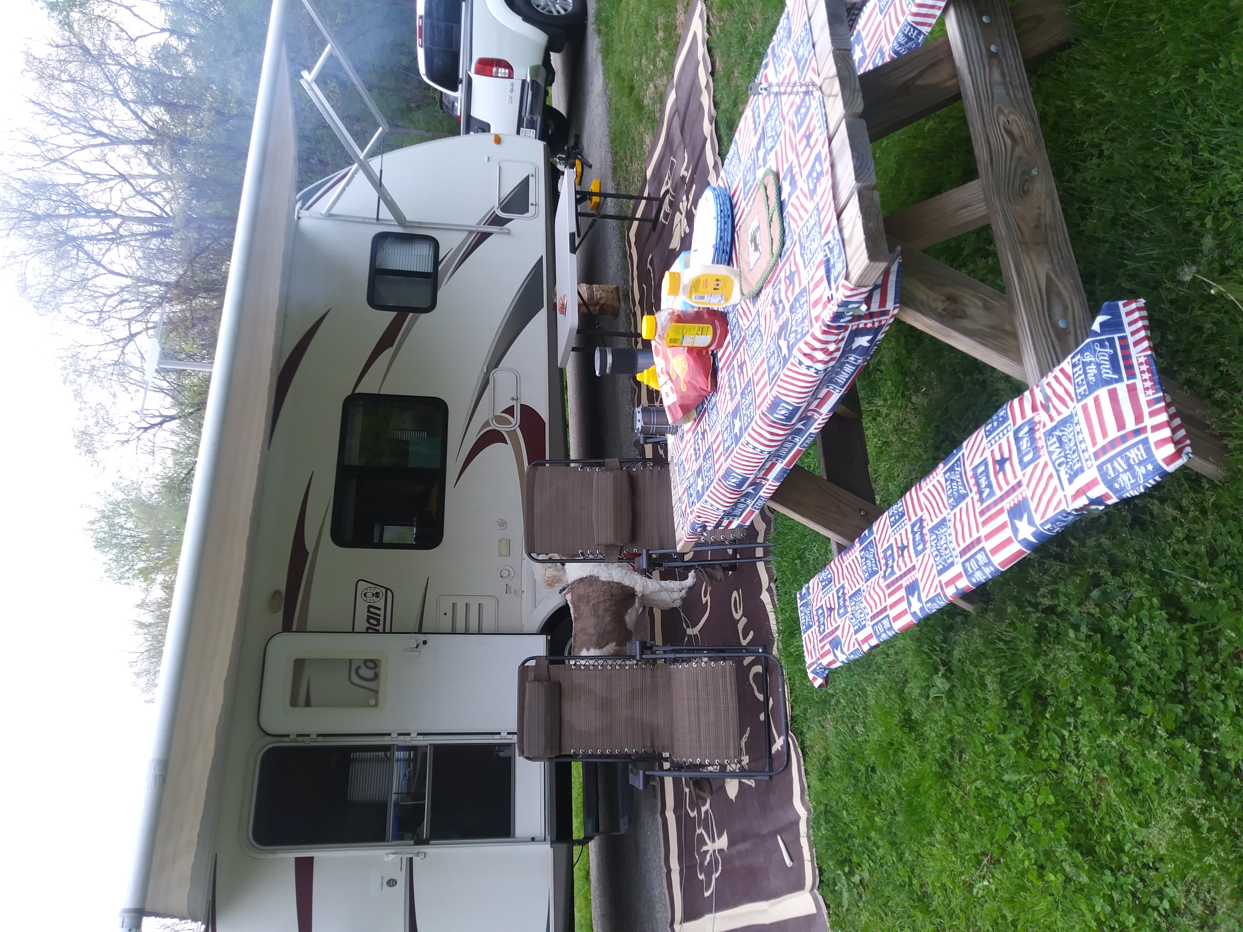 set up ready to enjoy the trip. 4 chairs, table cloths, table, rv mat. Dutchmen Coleman 2010
