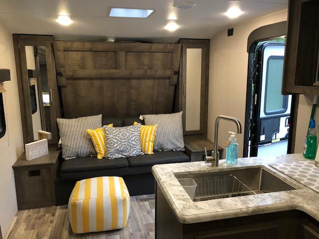 Murphy bed converted to comfy couch. K-Z Manufacturing CONNECT 2019