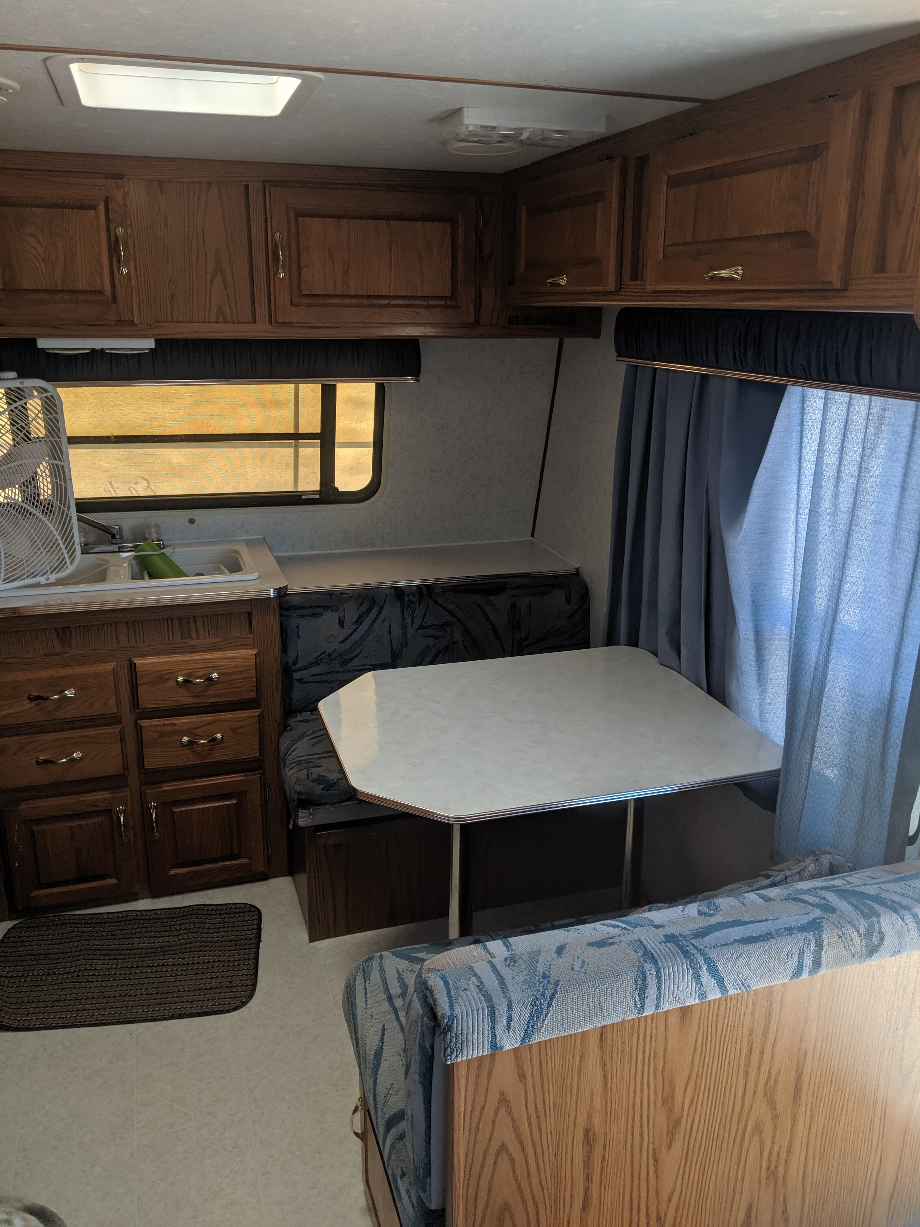 Inside table and kitchen sink with ample storage.. Jayco EAGLE 1997