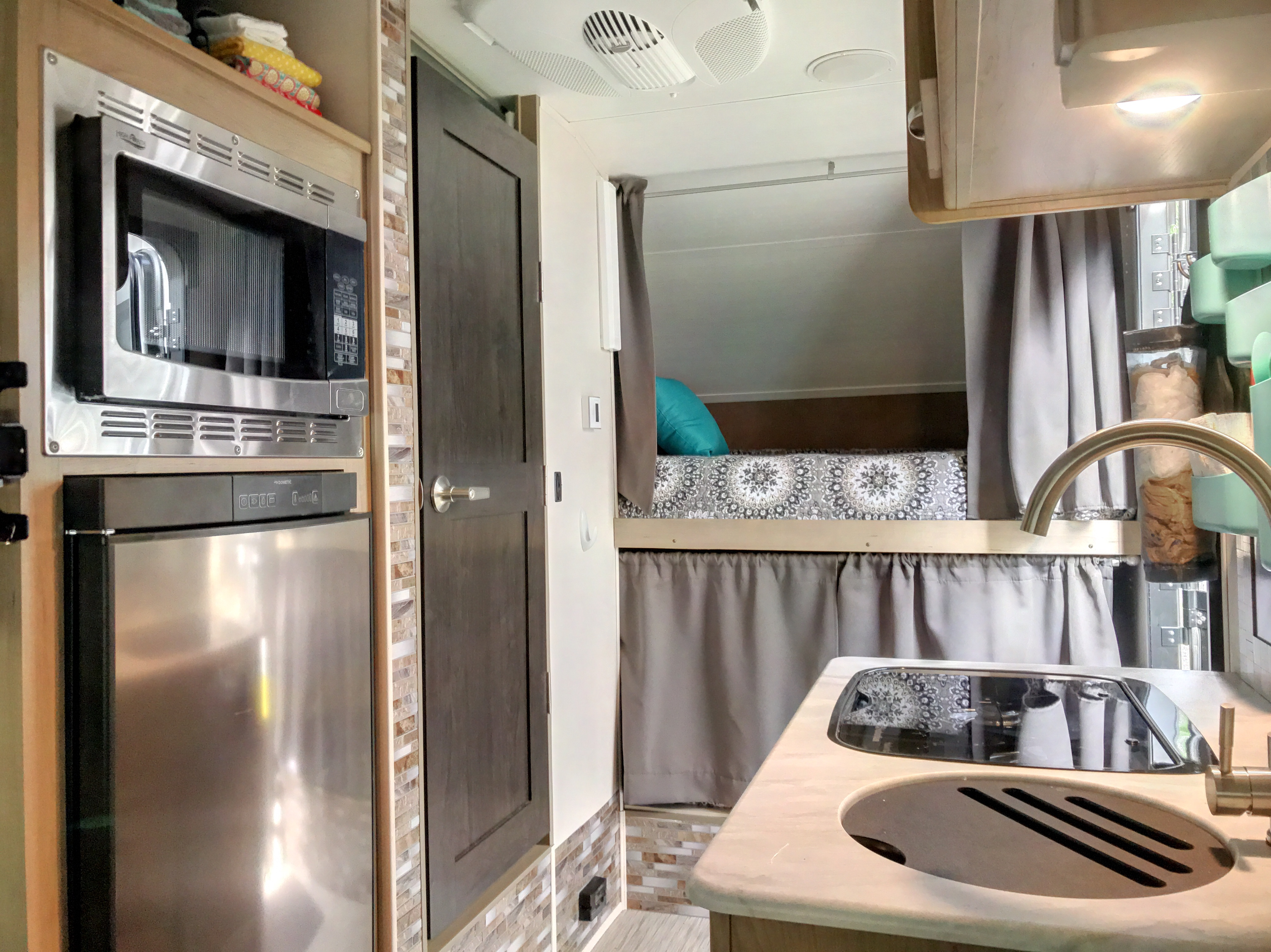 The cook top is covered with a glass top that raises when cook top is in use, but provides a smooth surface when when not in use.  The sink also has a cover to provide more counter space when sink is not in use.. Forest River R-Pod 172 2019