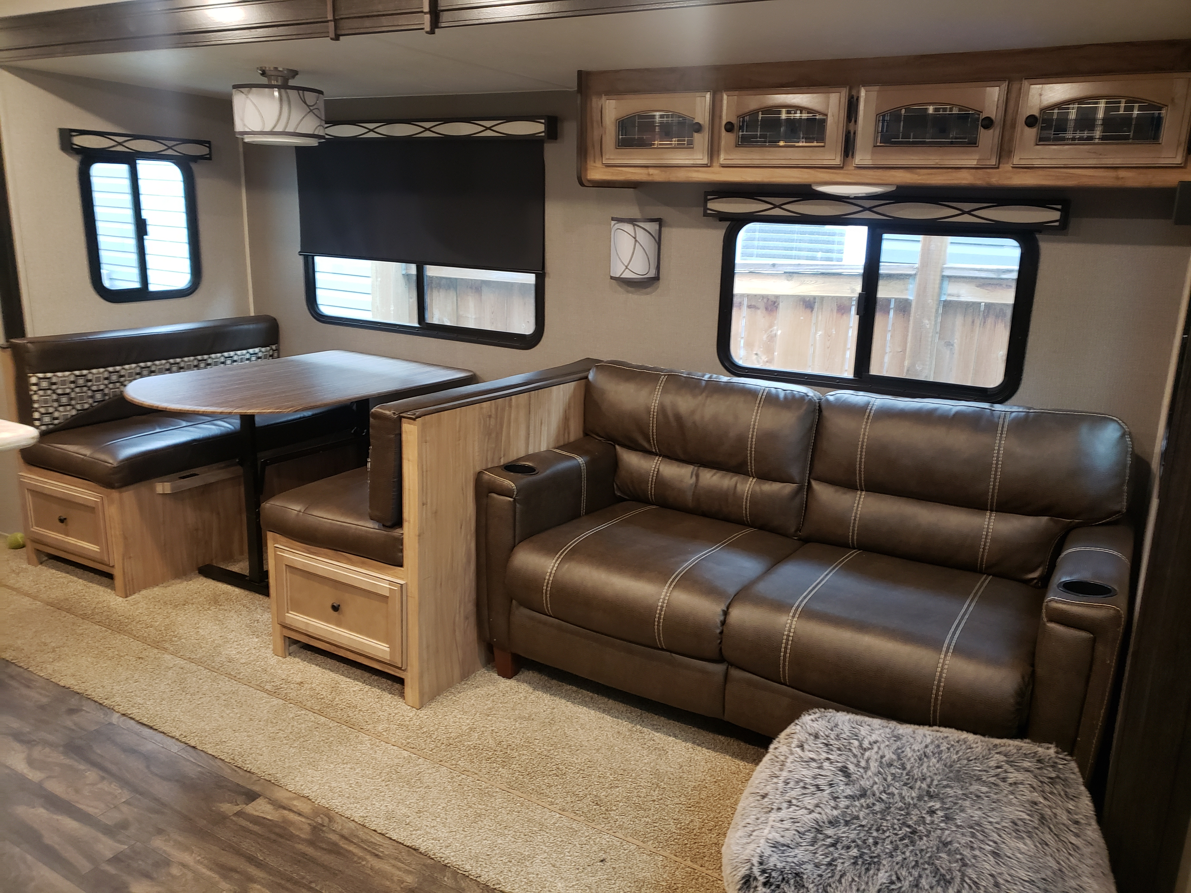 Dinning table and couch. Both fold down into beds.. Coachmen Freedom Express 2018