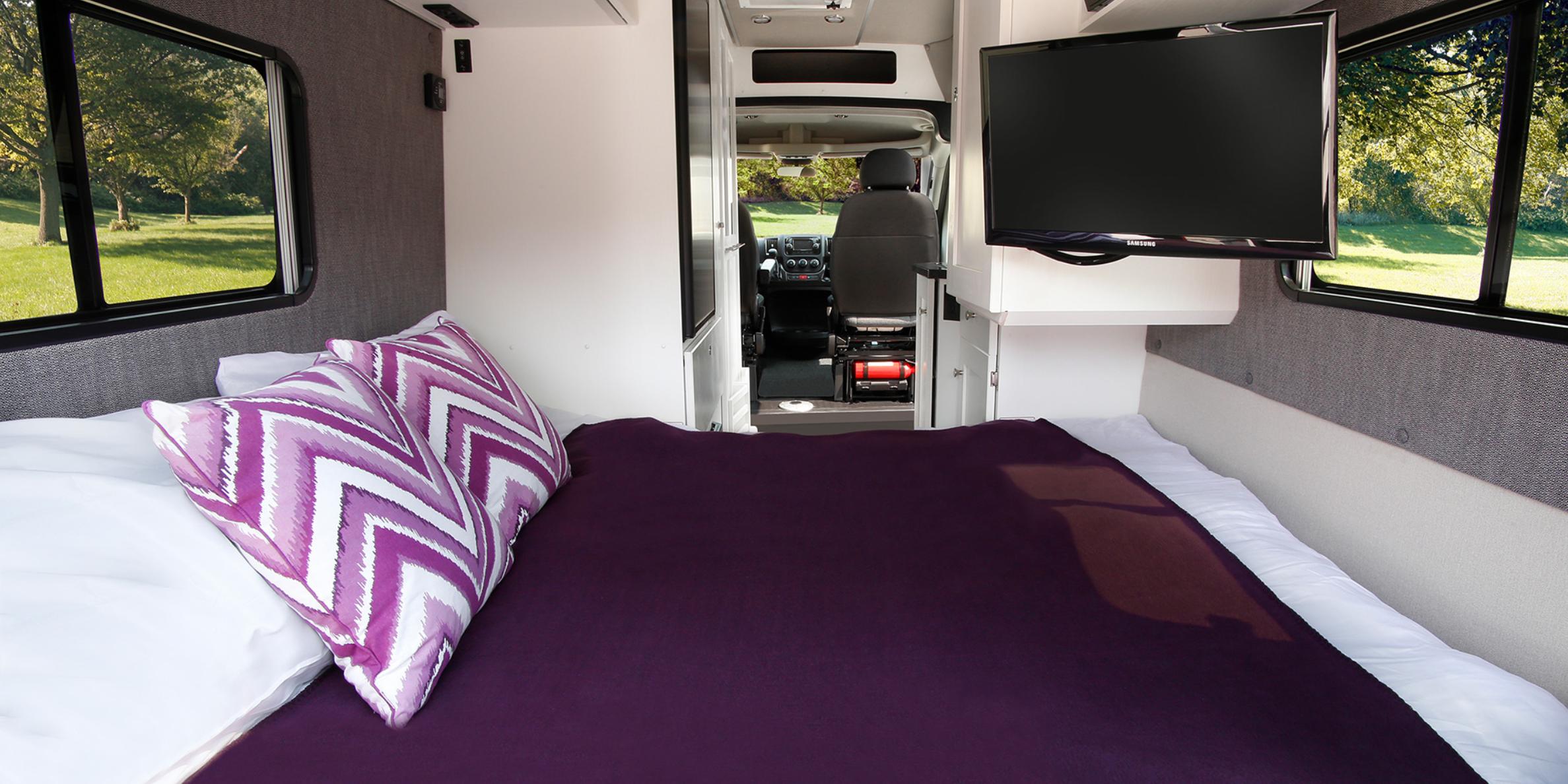 Forward facing power sofa easily converts to a comfortable queen size bed (Source: Roadtrek). Roadtrek Zion SRT 2019