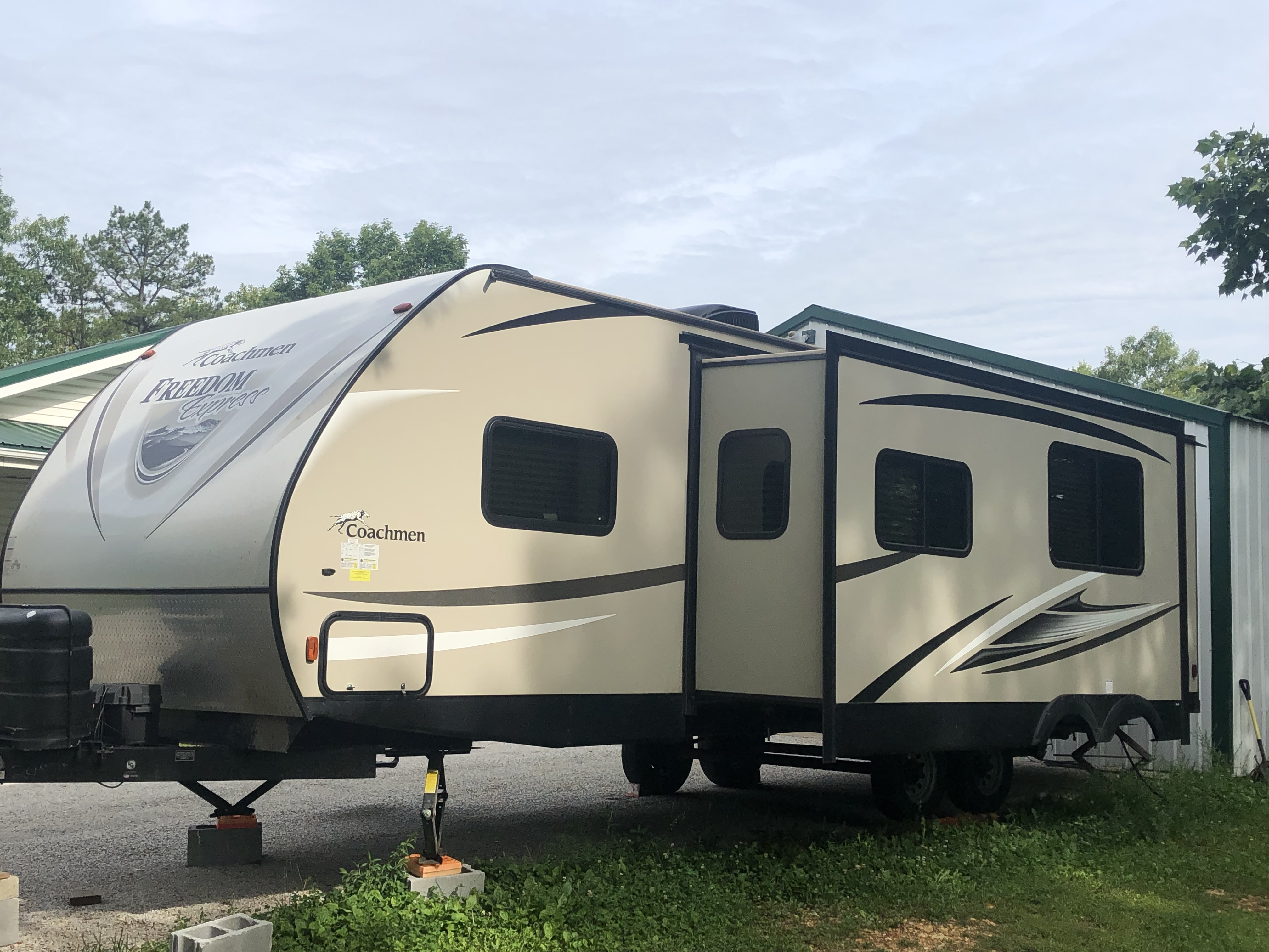 Exterior of camper with the slide out extended. Coachmen Freedom Express 2017