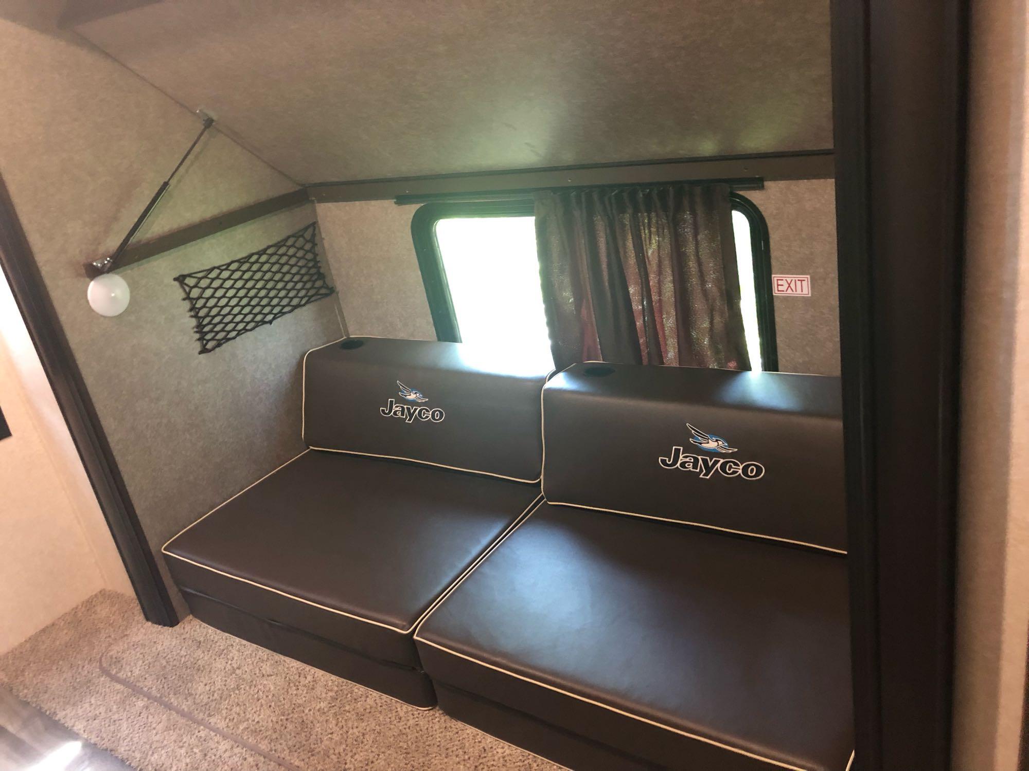 overhead bunk folded up. Jayco Flight 2020