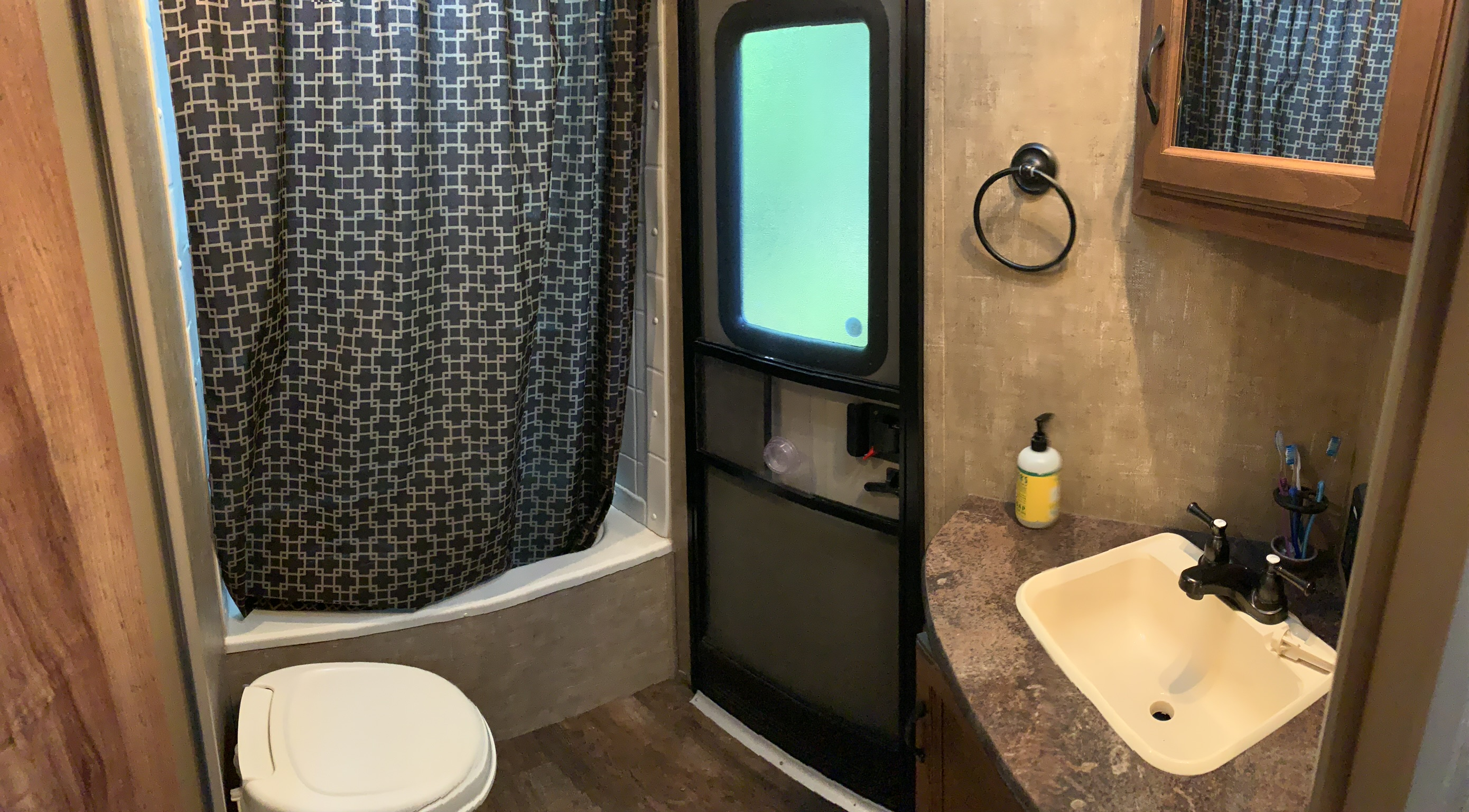 Plenty of space to shower and refresh after an enjoyable day of camping. Exterior entrance to the bathroom makes camping with kids or friends sleeping in a tent easy!. K-Z Manufacturing Spree 2015