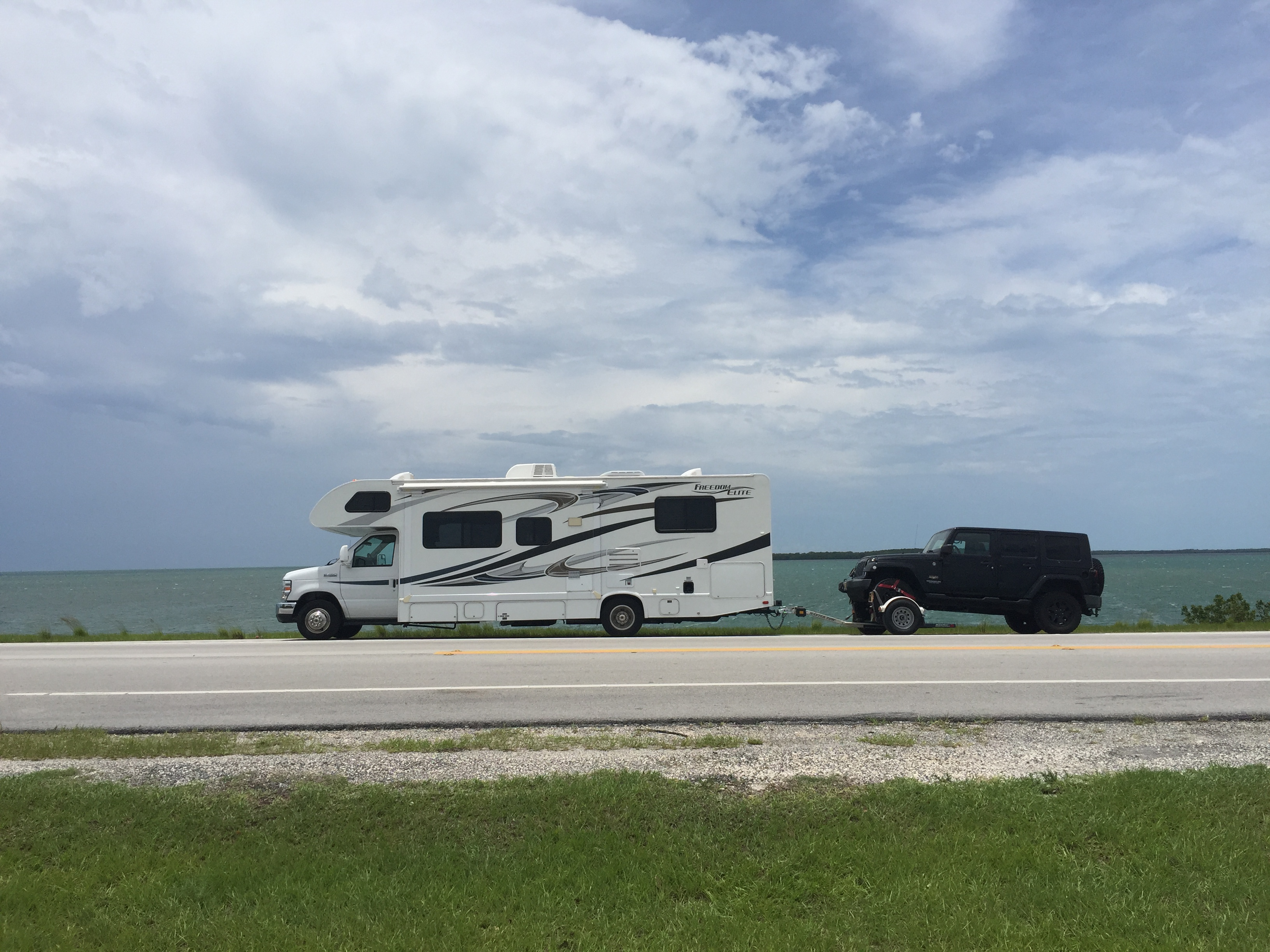 Florida Keys  RV pulling a Jeep on a dolly. Thor Motor Coach Freedom Elite 2012