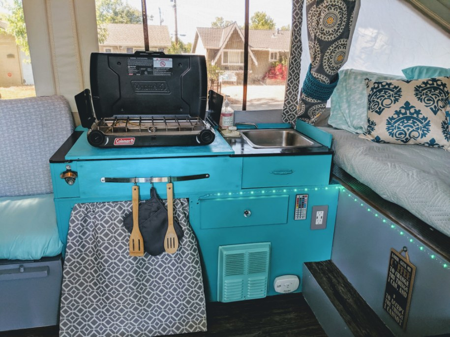 The kitchenette includes a gas stove, sink, ice chest nook and of course a mounted beer bottle opener. . Jayco 806 1992